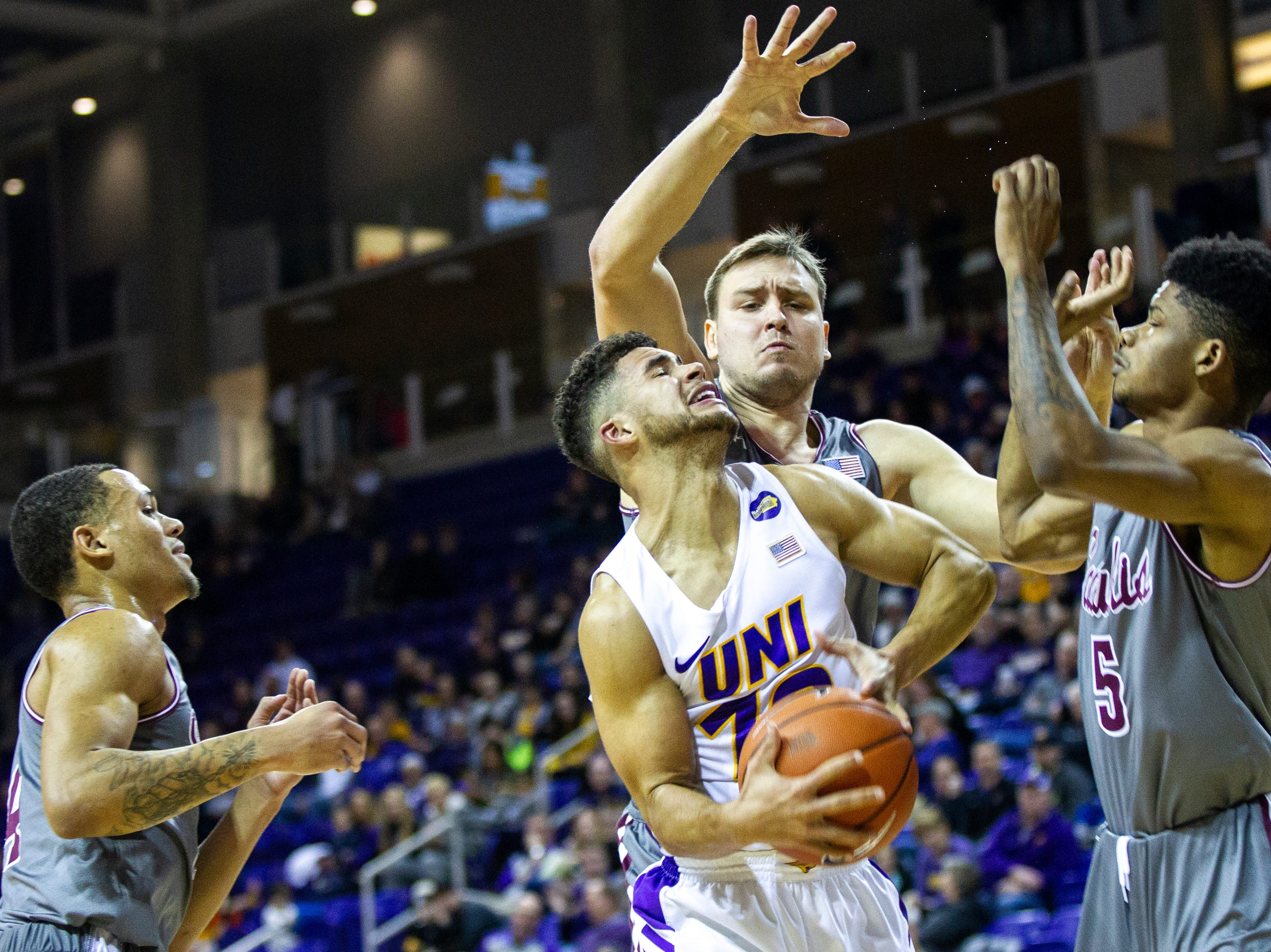 Northern Iowa guard Mile Wentzien gets fouled while going to the basket during a NCAA Missouri Valley Conference men's basketball game on Saturday, Jan. 5, 2019, at the McLeod Center in Cedar Falls, Iowa.