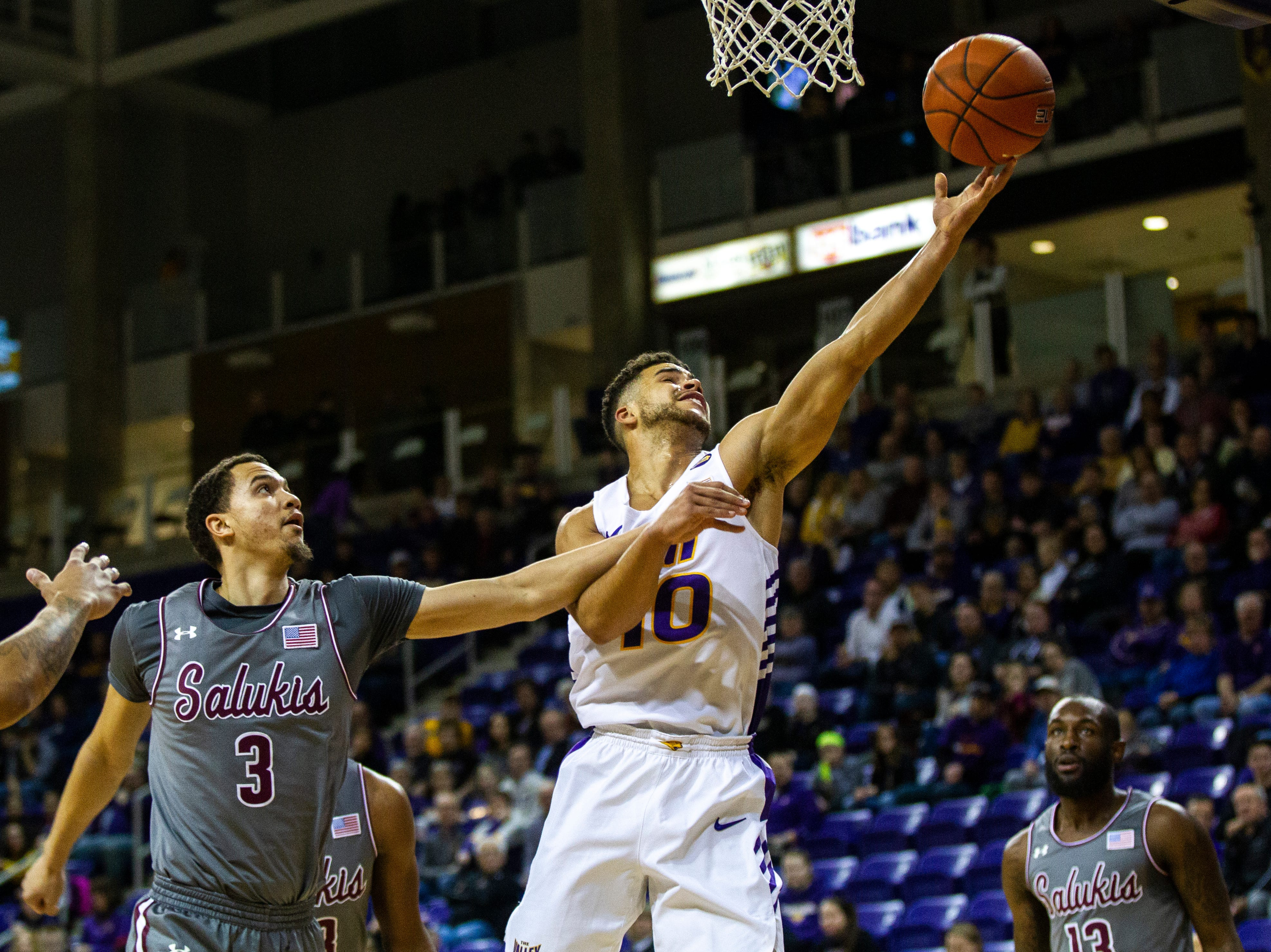 Northern Iowa guard Miles Wentzien makes a layup past Southern Illinois guard Marcus Bartley (3) during a NCAA Missouri Valley Conference men's basketball game on Saturday, Jan. 5, 2019, at the McLeod Center in Cedar Falls, Iowa.
