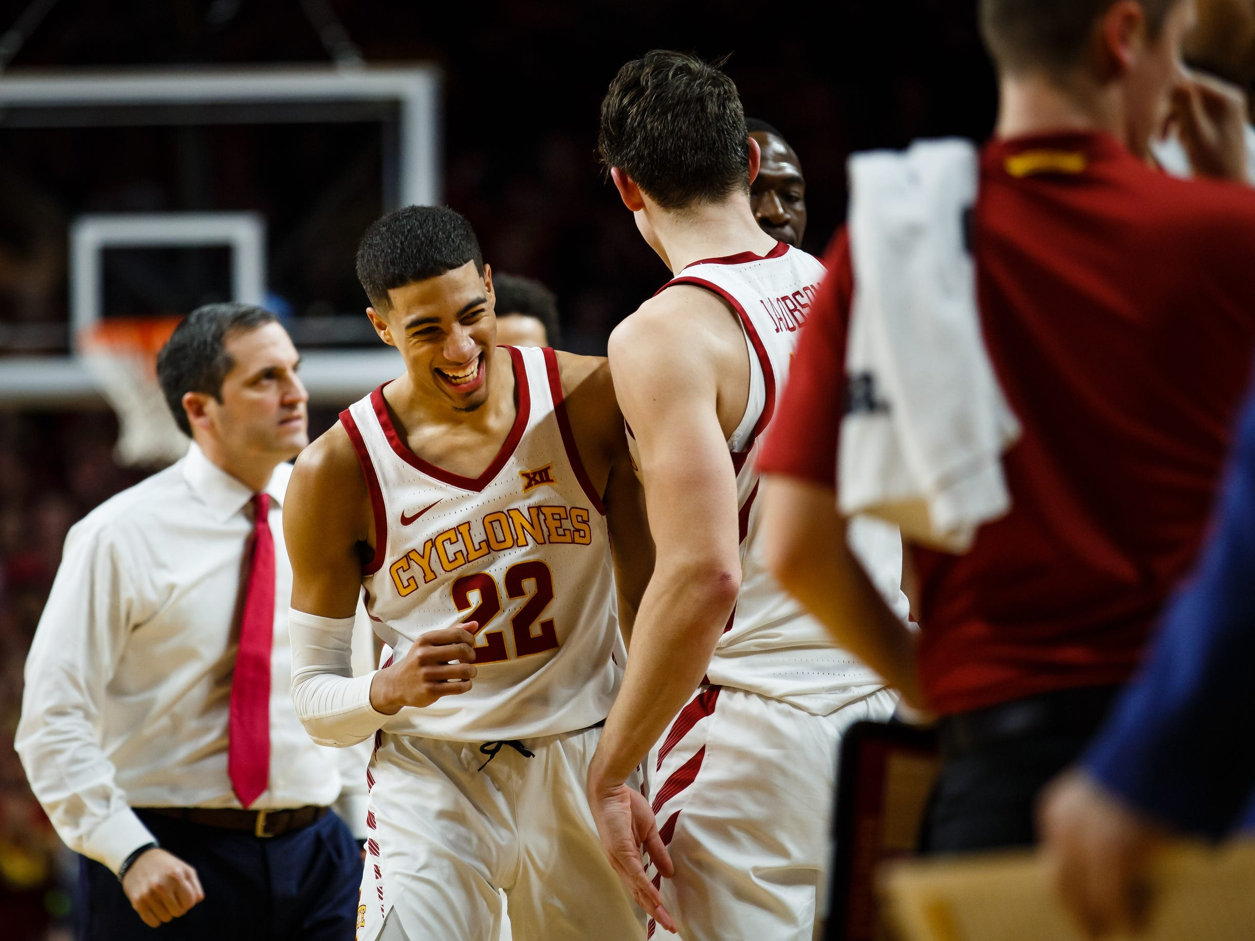 Iowa State's Tyrese Haliburton (22) is congratulated as he returned to the bench during the second half of their basketball game on Saturday, Jan. 5, 2019, in Ames. Iowa State would go on to beat Kansas 77-60.