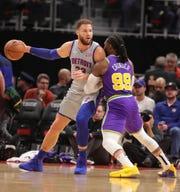 Blake Griffin posts against Jazz forward Jae Crowder, Jan. 5, 2019 in Detroit.