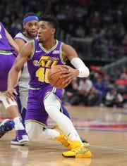 Detroit Pistons guard Bruce Brown defends Utah Jazz guard Donovan Mitchell, Saturday, Jan. 5, 2019 at Little Caesars Arena in Detroit.