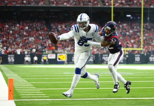 Eric Ebron scores past Texans safety Tyrann Mathieu in the first quarter in a AFC wildcard playoff game Saturday in Houston.