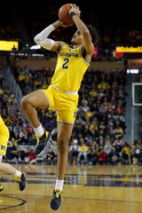 Michigan guard Jordan Poole scores against Indiana during the first half on Sunday, January 6, 2019 at Crisler Center in Ann Arbor.