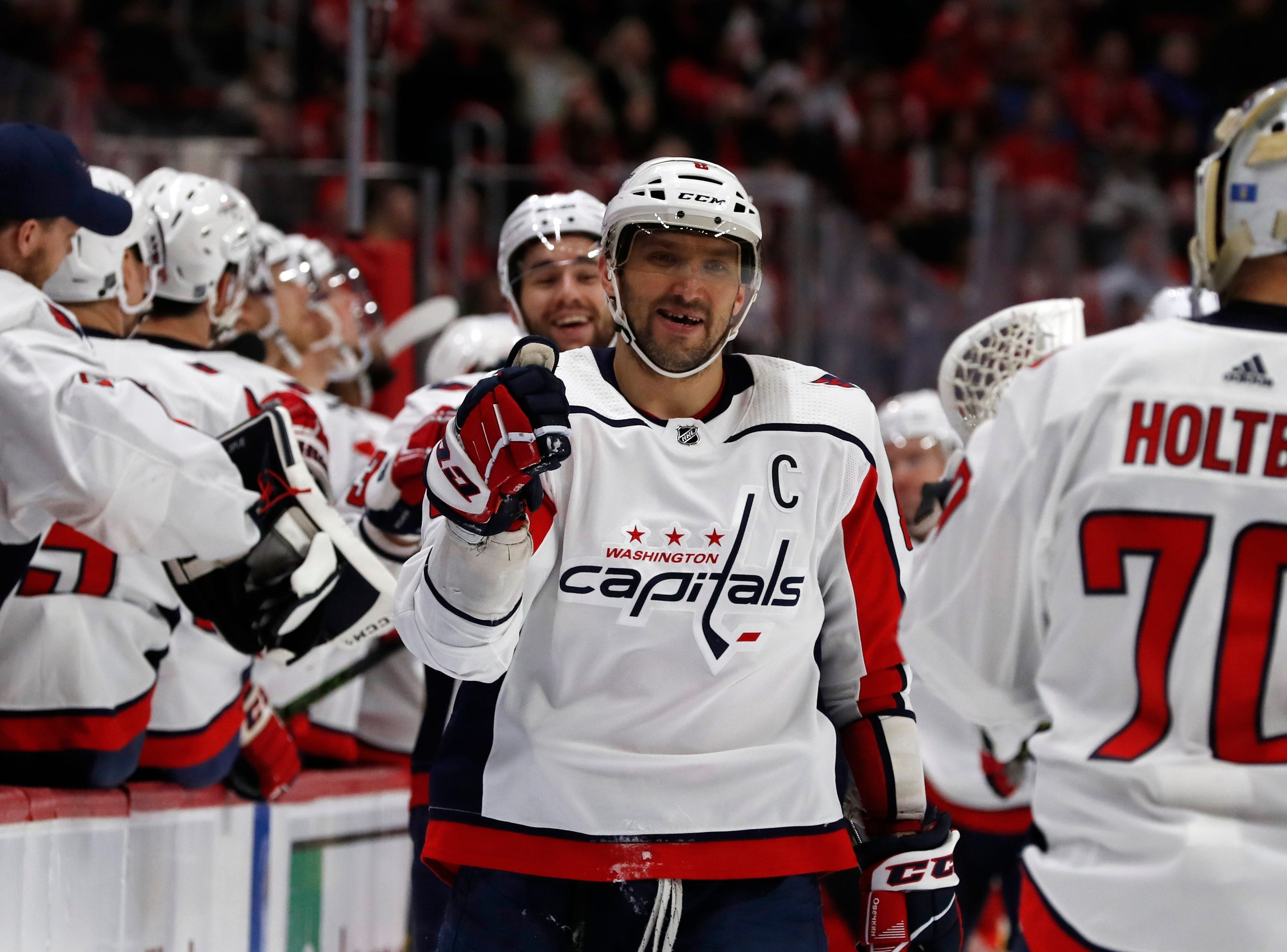 Washington Capitals left wing Alex Ovechkin greets teammates after Tom Wilson scores on Detroit Red Wings goaltender Jimmy Howard during the first period.