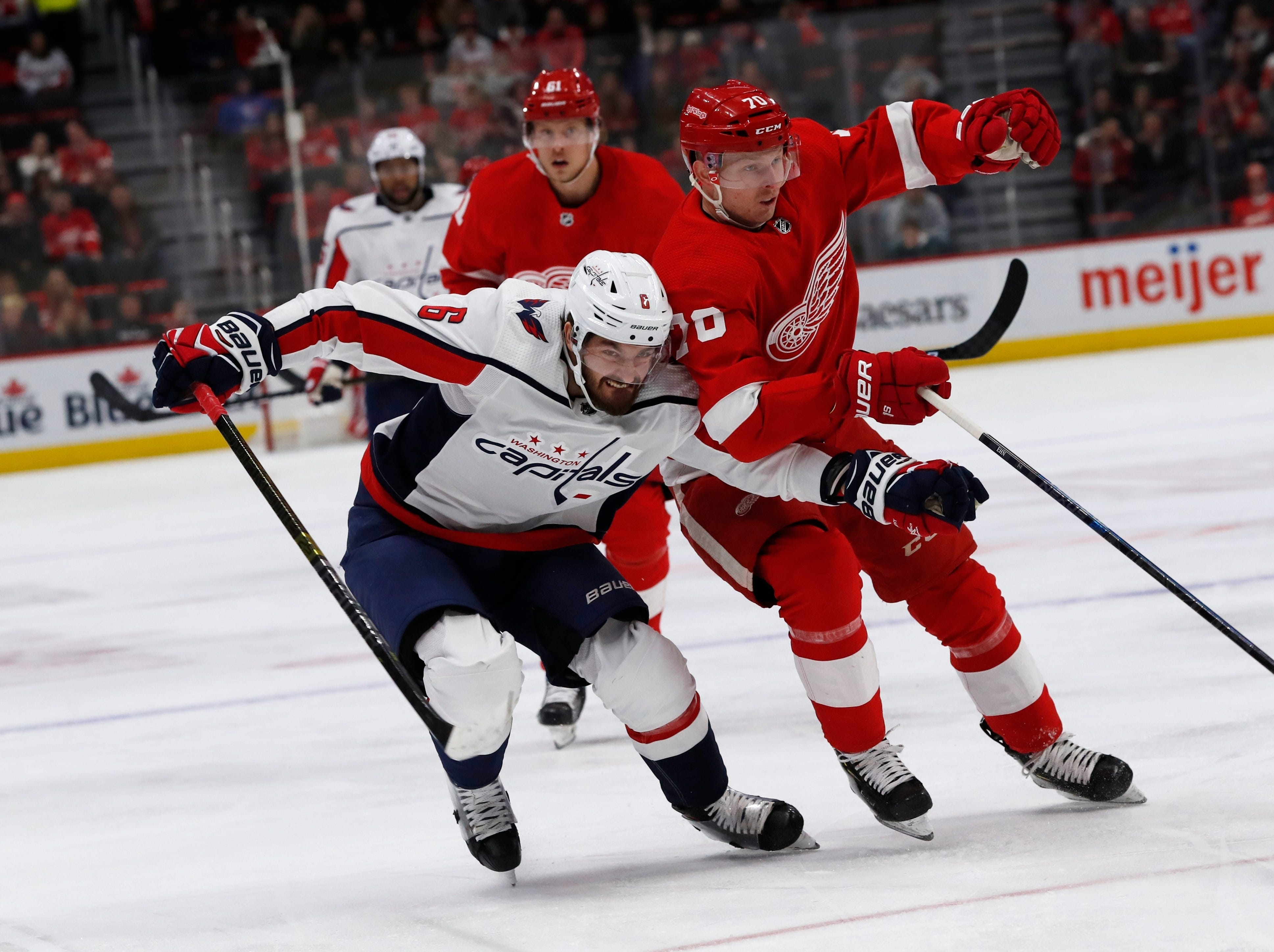 Washington Capitals defenseman Michal Kempny (6) and Detroit Red Wings center Christoffer Ehn (70) chase the puck during the first period.