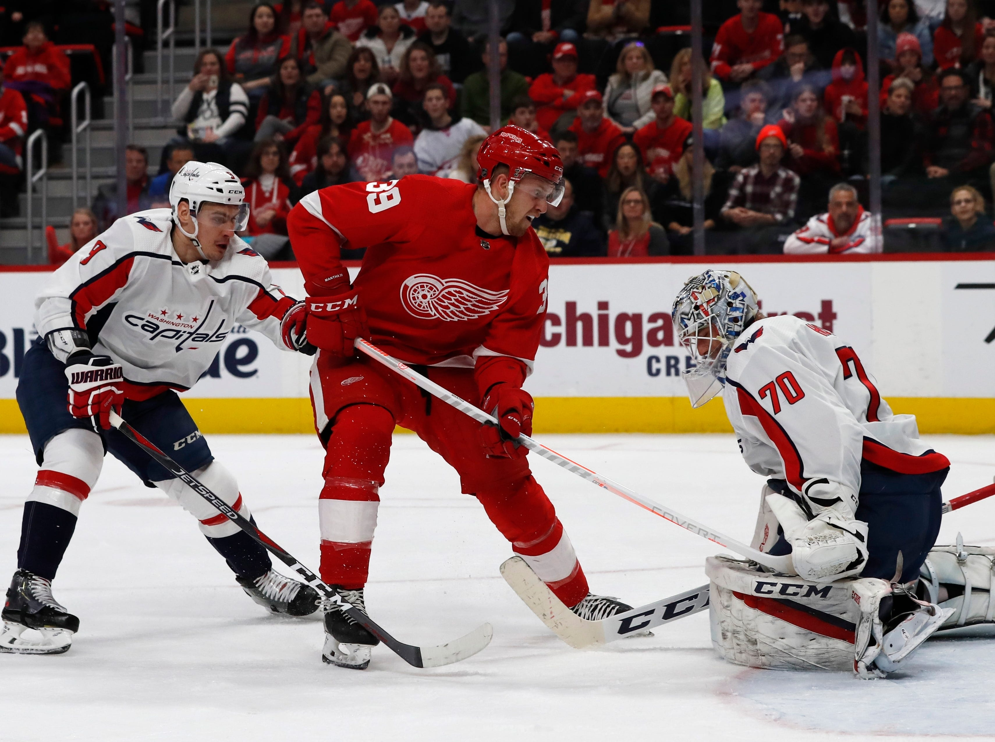 Detroit Red Wings right wing Anthony Mantha (39) shoots the puck past Washington Capitals goaltender Braden Holtby (70) for a goal during the first period of an NHL hockey game, Sunday, Jan. 6, 2019, in Detroit.