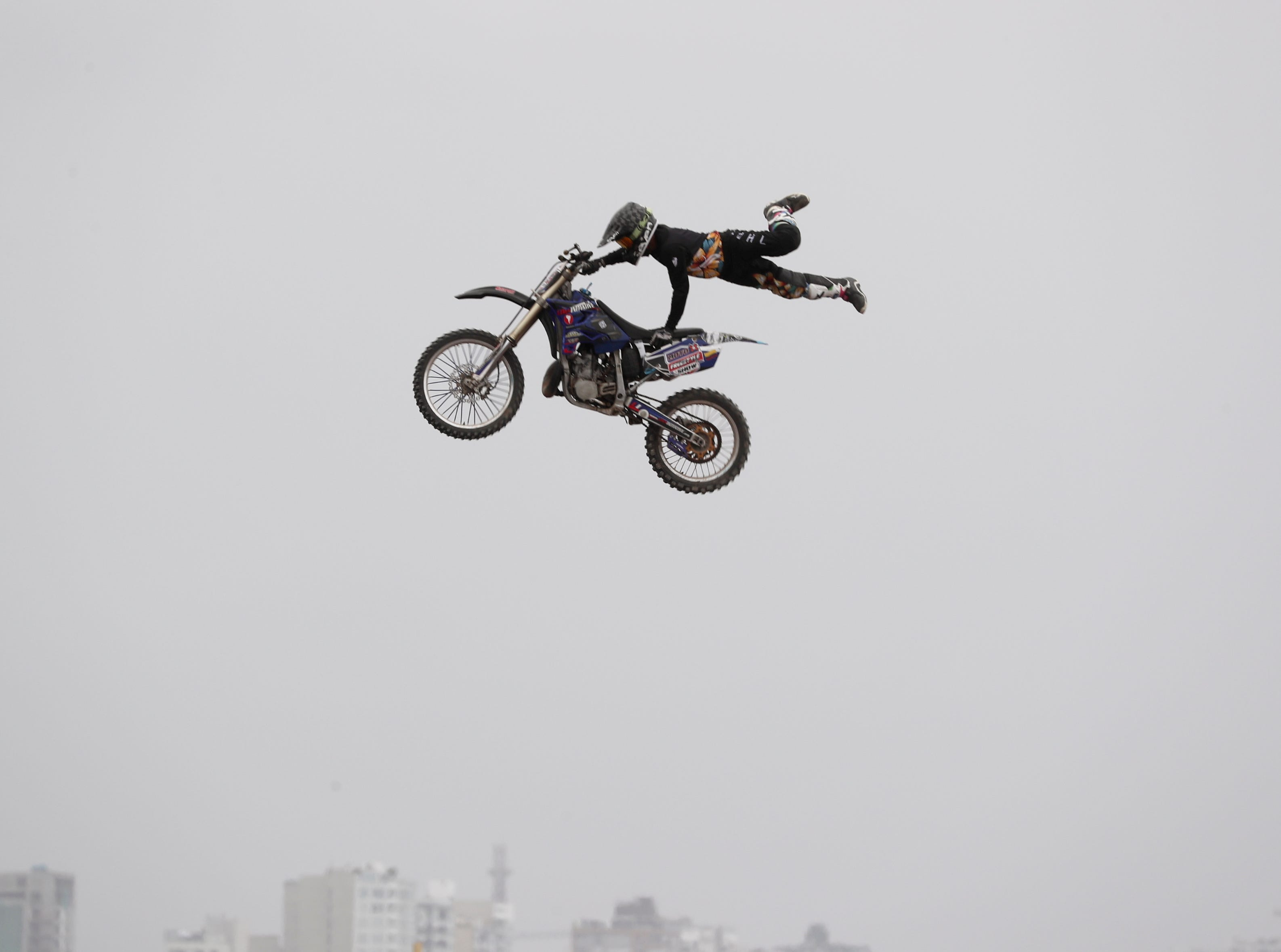 A rider performs before the start of the Dakar Rally in Lima, Peru, Sunday, Jan. 6, 2019. The 41st edition of Dakar Rally starts in Lima on Jan. 7.