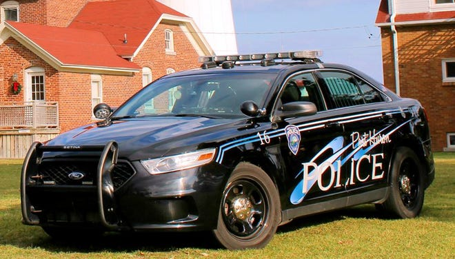 Port Huron police say officers shot and critically wounded a man holding a knife who charged at them.
