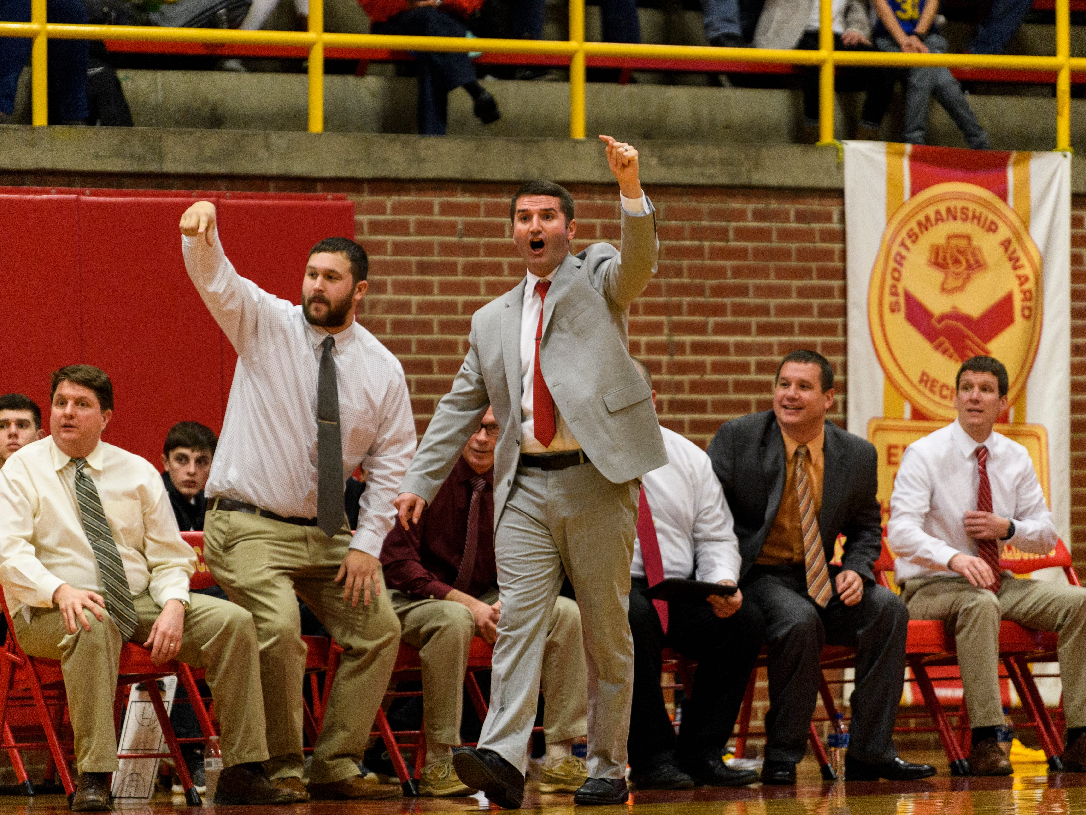 Mater Dei Head Coach Kurt Wildeman, center, and his coaching staff react to a foul call made against the Boonville Pioneers at Mater Dei High School in Evansville, Ind., Saturday, Jan. 5, 2019. The Wildcats defeated the Pioneers, 93-65.