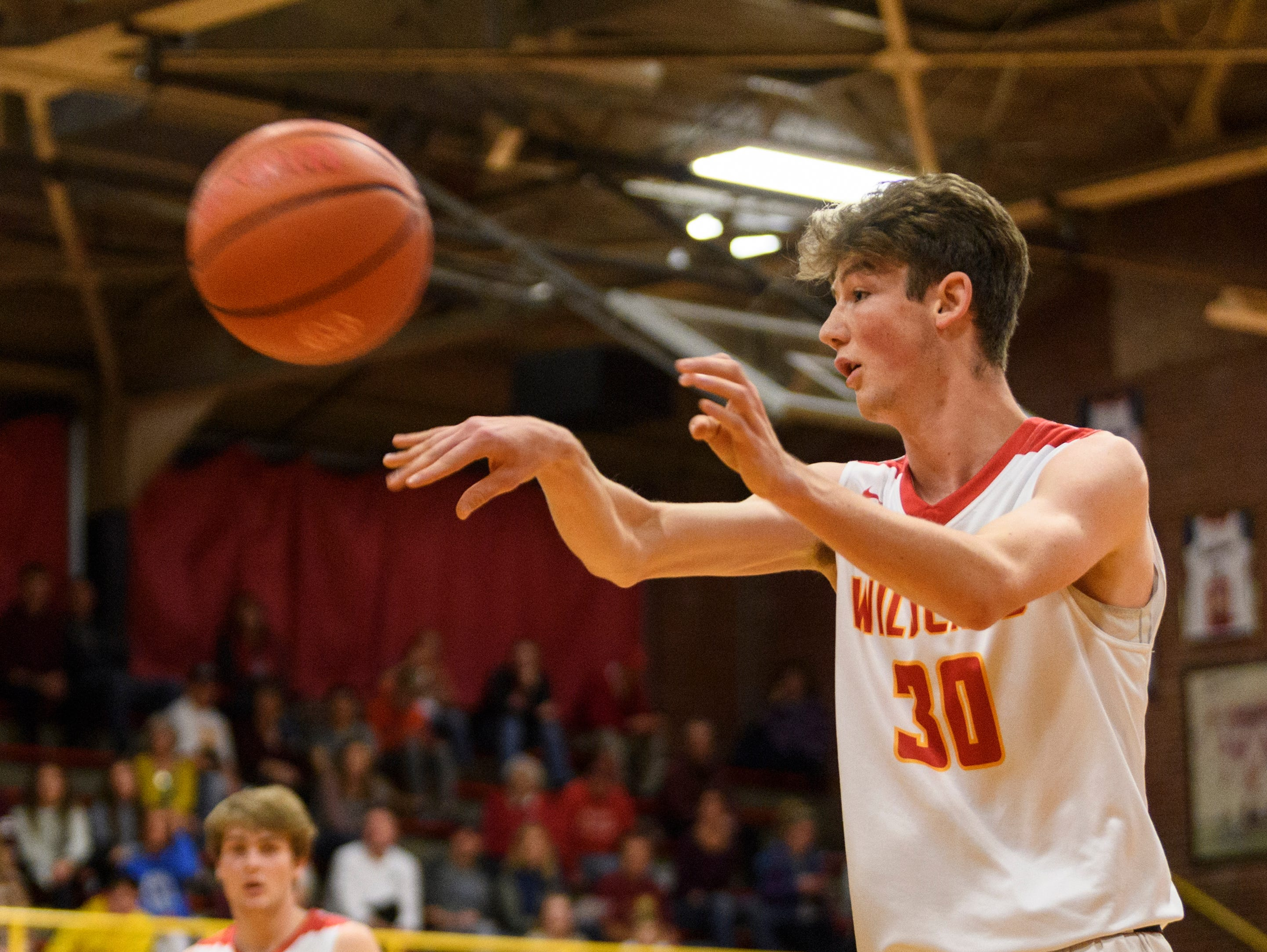Mater Dei's Zach Schoenstien (30) passes to a teammate during the first quarter against the Boonville Pioneers at Mater Dei High School in Evansville, Ind., Saturday, Jan. 5, 2019. The Wildcats defeated the Pioneers, 93-65.