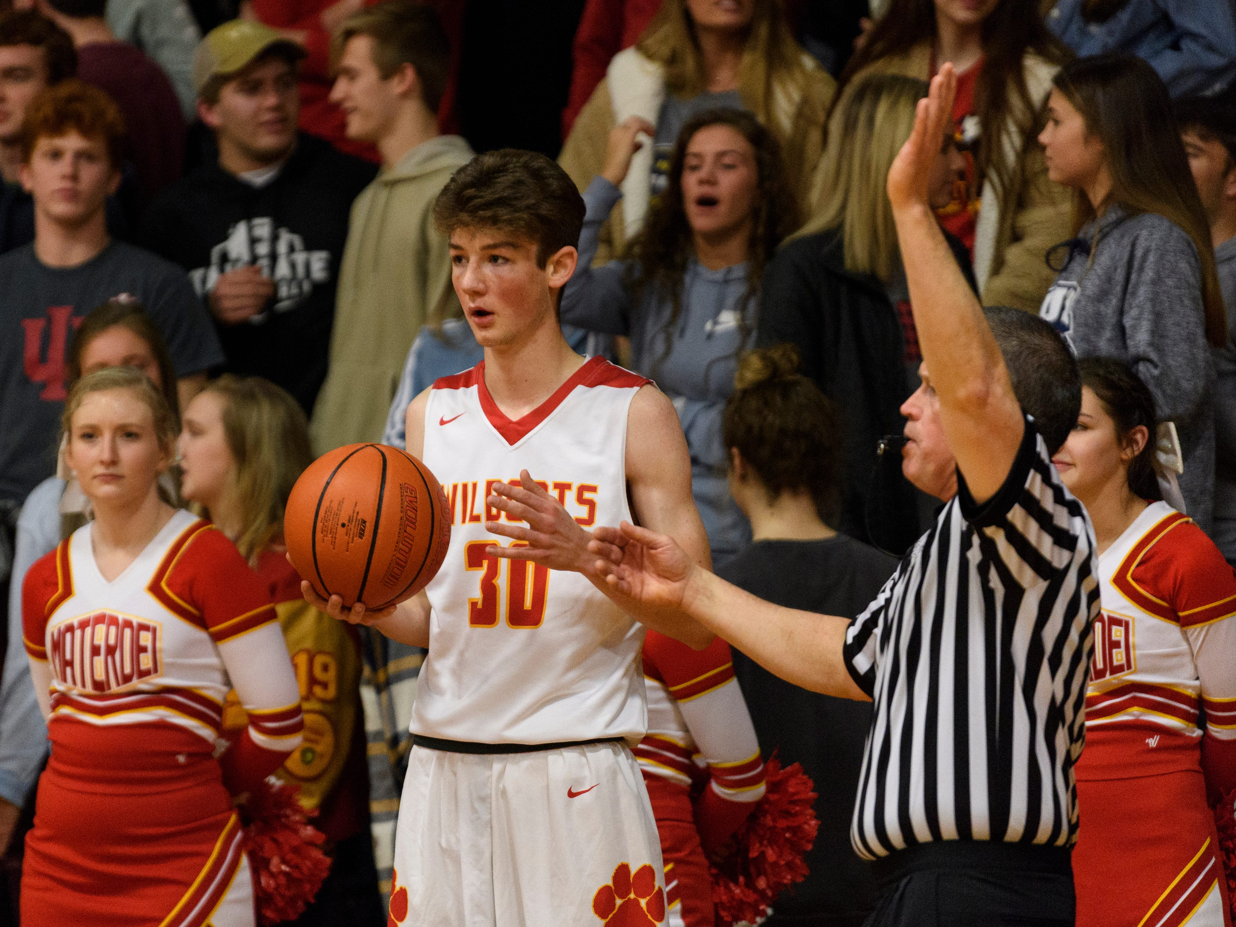 Mater Dei's Zach Schoenstien (30) prepares to throw the ball into play during the second quarter against the Boonville Pioneers at Mater Dei High School in Evansville, Ind., Saturday, Jan. 5, 2019. The Wildcats defeated the Pioneers, 93-65.