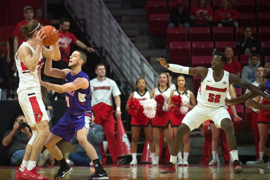 Evansville's Shea Feehan guards Illinois State's Matt Chastain during the Purple Aces' 58-46 Missouri Valley Conference loss to the Redbirds on Saturday, Jan. 5, 2019, at Redbird Arena in Normal, Ill.