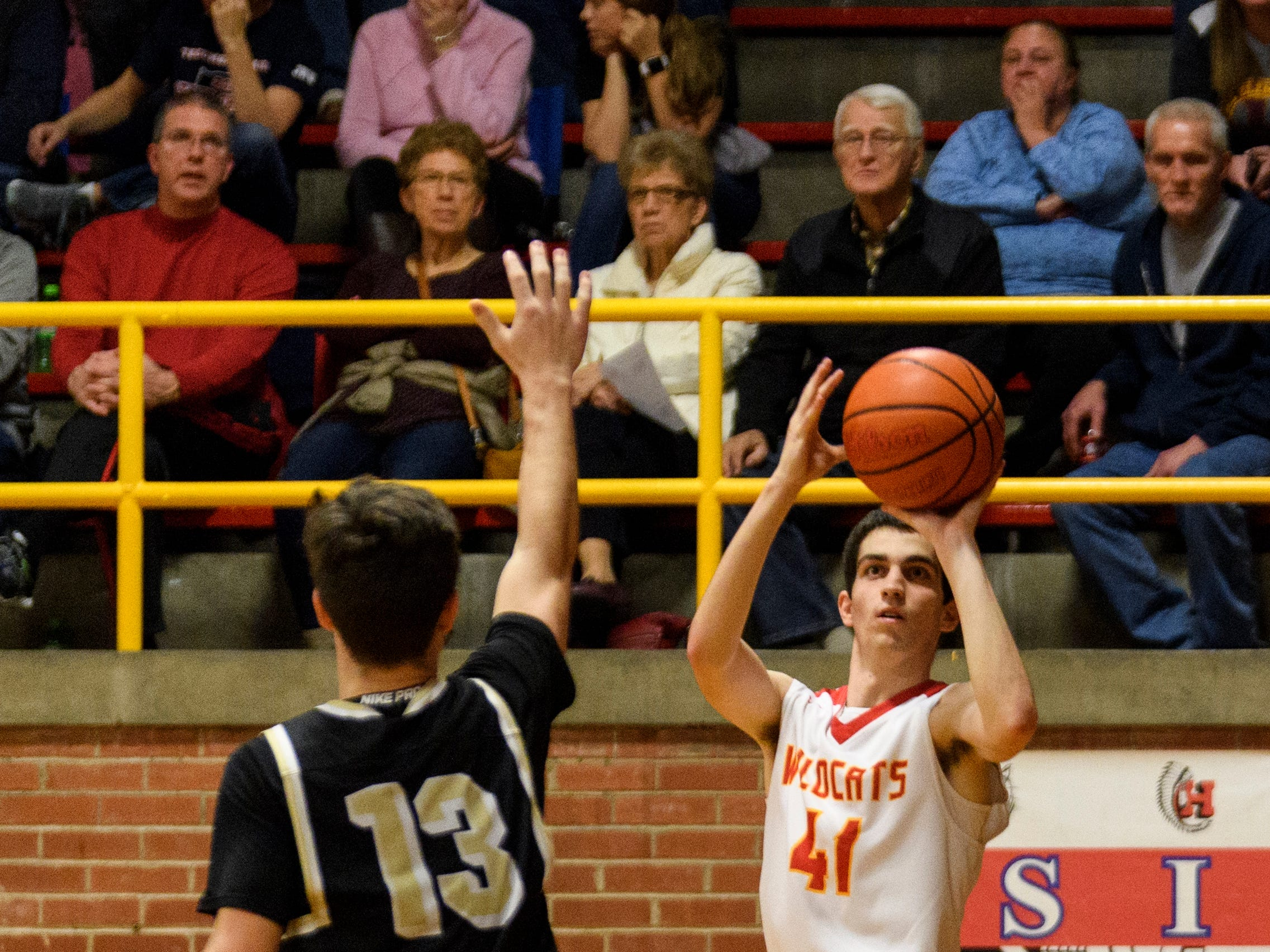 Mater Dei's Andy Heldman (41) makes a three-pointer during the second quarter against the Boonville Pioneers at Mater Dei High School in Evansville, Ind., Saturday, Jan. 5, 2019. The Wildcats defeated the Pioneers, 93-65.