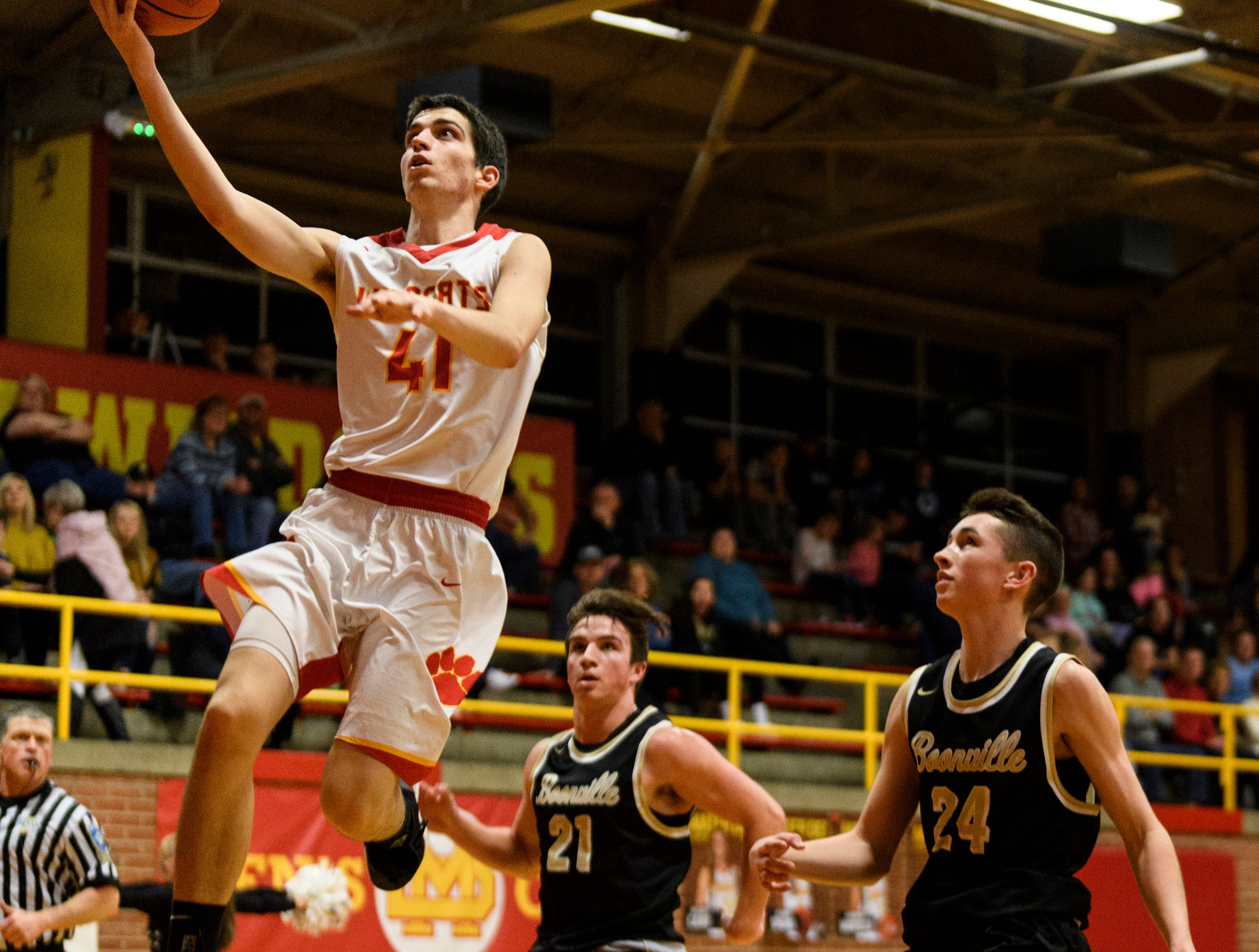 Mater Dei's Andy Heldman (41) drives to the net for a lay-up during the third quarter against the Boonville Pioneers at Mater Dei High School in Evansville, Ind., Saturday, Jan. 5, 2019. The Wildcats defeated the Pioneers, 93-65.