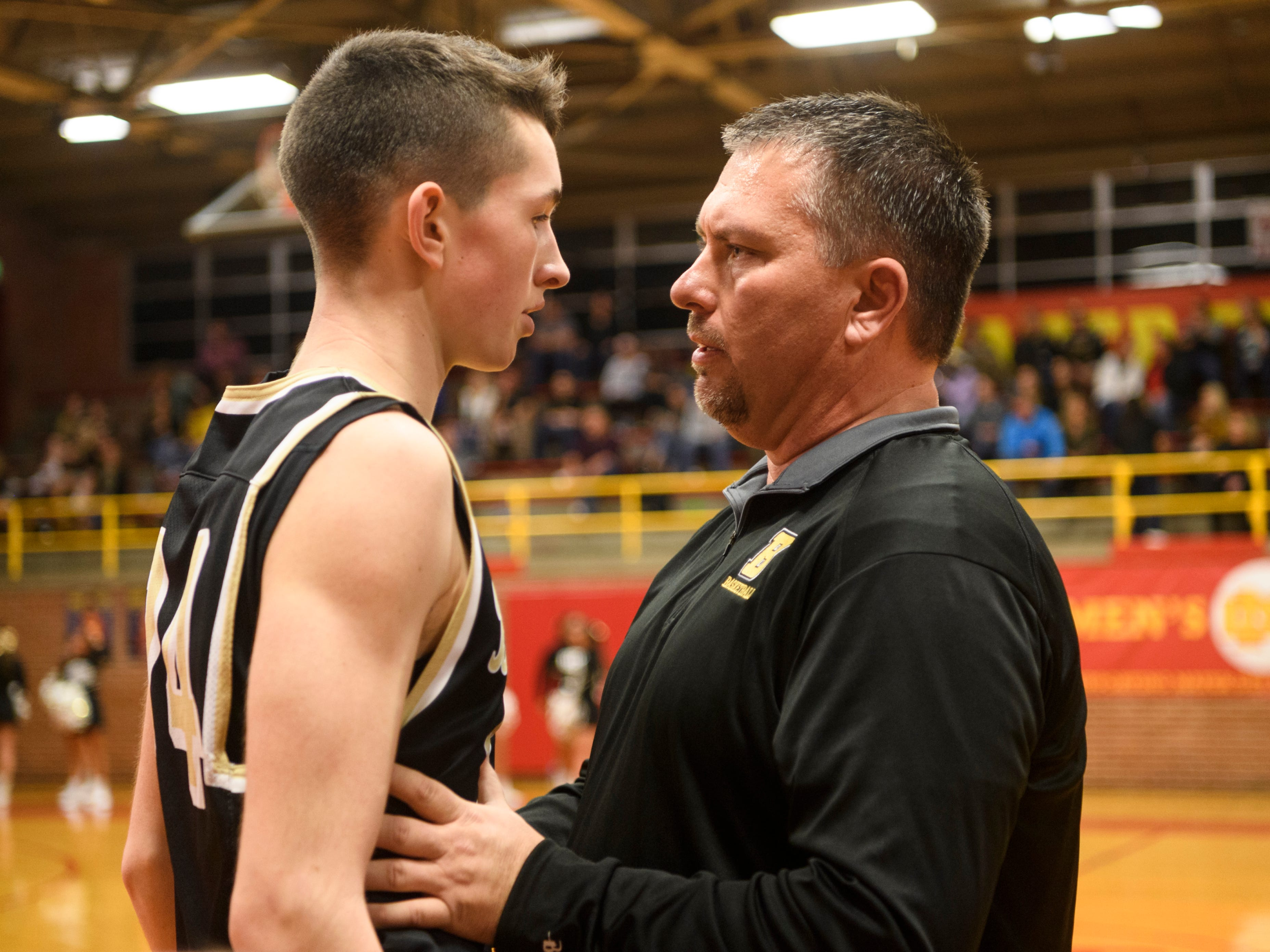Boonville Head Coach Brian Schoonover talks to Maddux Brunner (24) during the second quarter against the Mater Dei Wildcats at Mater Dei High School in Evansville, Ind., Saturday, Jan. 5, 2019. The Wildcats defeated the Pioneers, 93-65.