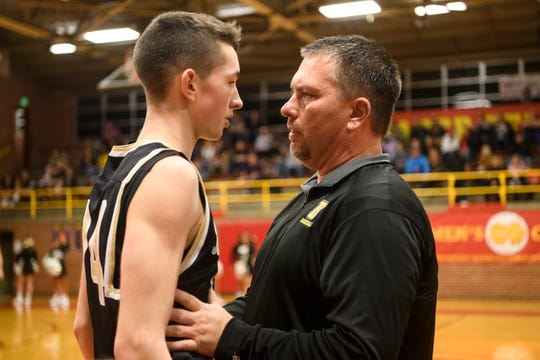 Boonville Head Coach Brian Schoonover talks to Maddux Brunner (24) during the second quarter against the Mater Dei Wildcats at Mater Dei High School in Evansville, Ind., Saturday, Jan. 5, 2019.