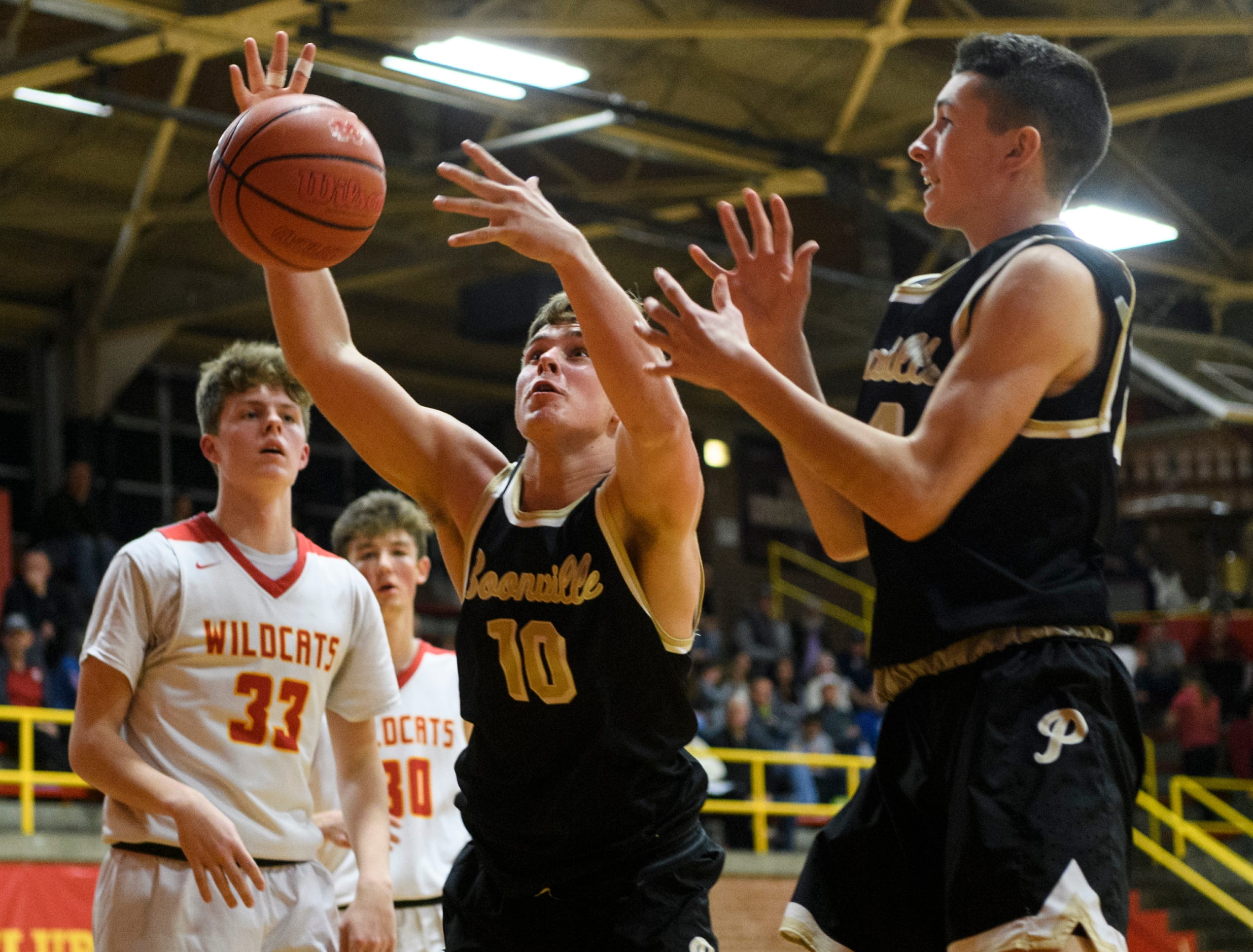 Boonville's Jackson Phillips (10) grabs the rebound during the third quarter against the Mater Dei Wildcats at Mater Dei High School in Evansville, Ind., Saturday, Jan. 5, 2019. The Wildcats defeated the Pioneers, 93-65.