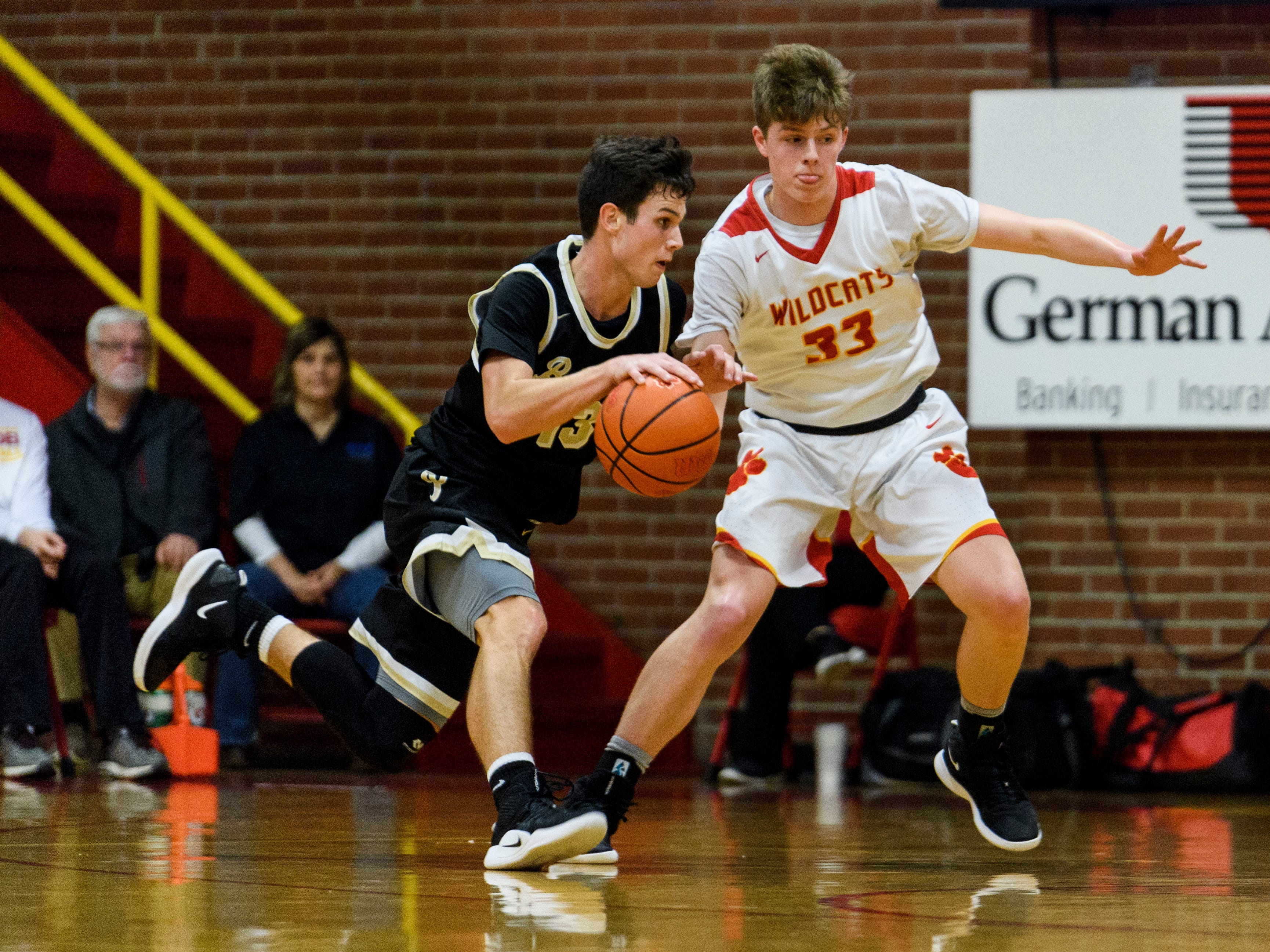 Mater Dei's Jackson Hiester (33) guards Boonville's Rylan Hicks (13) during the first quarter at Mater Dei High School in Evansville, Ind., Saturday, Jan. 5, 2019. The Wildcats defeated the Pioneers, 93-65.