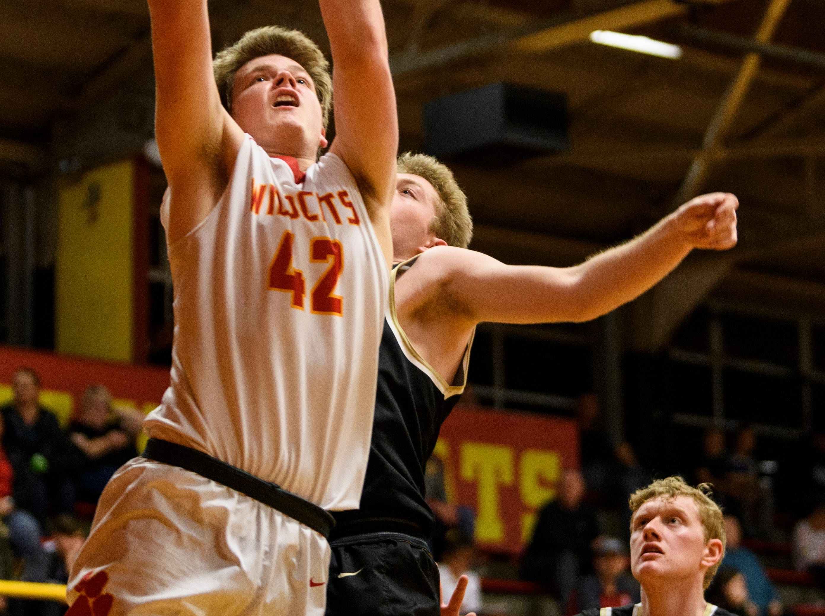 Mater Dei's Tyler Phelps (42) advances to the net during the third quarter against the Boonville Pioneers at Mater Dei High School in Evansville, Ind., Saturday, Jan. 5, 2019. The Wildcats defeated the Pioneers, 93-65.