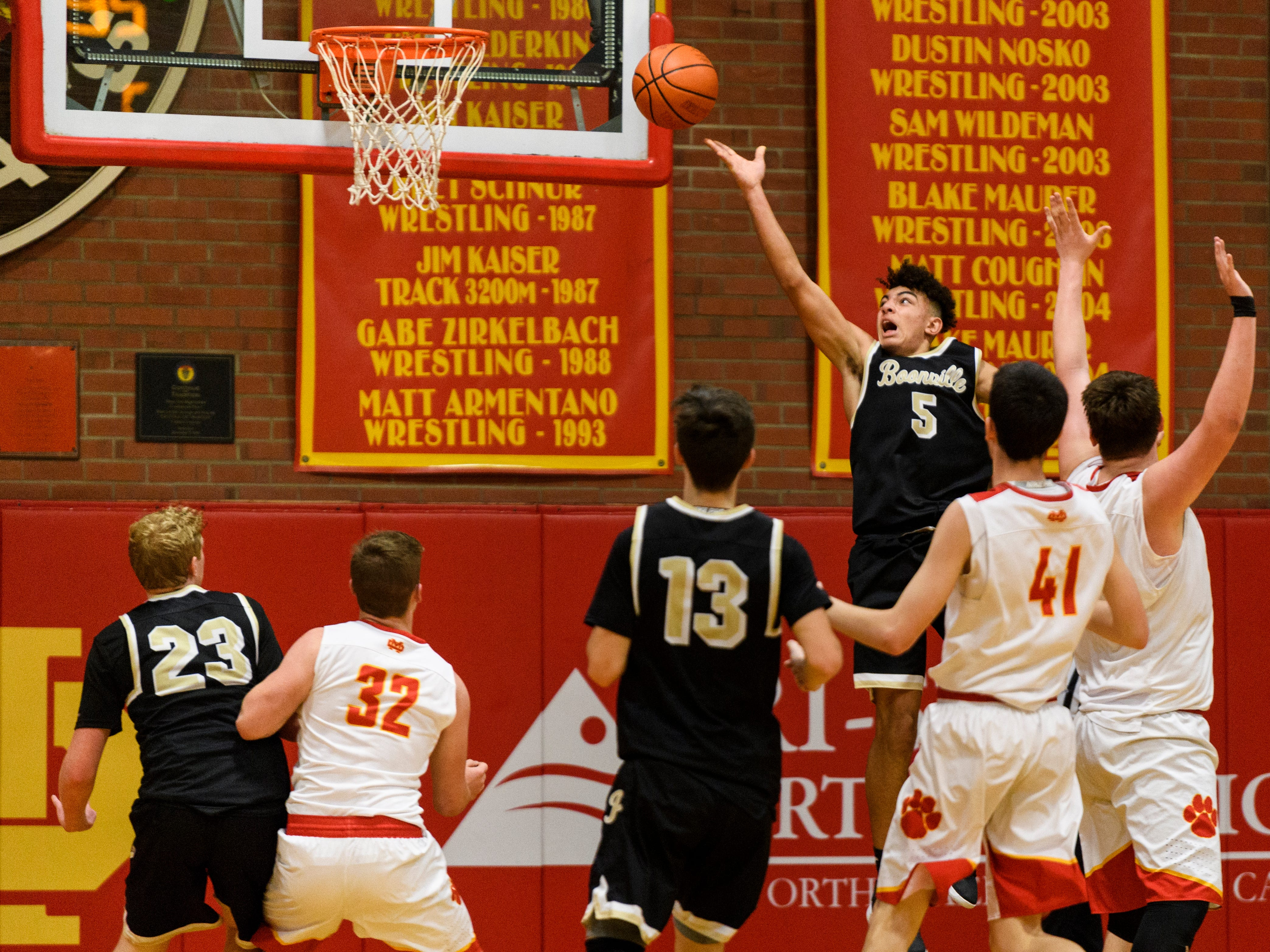 Boonville's Devin Mockobee (5) throws the ball up during a shot attempt in the second quarter against the Mater Dei Wildcats at Mater Dei High School in Evansville, Ind., Saturday, Jan. 5, 2019. The Wildcats defeated the Pioneers, 93-65.