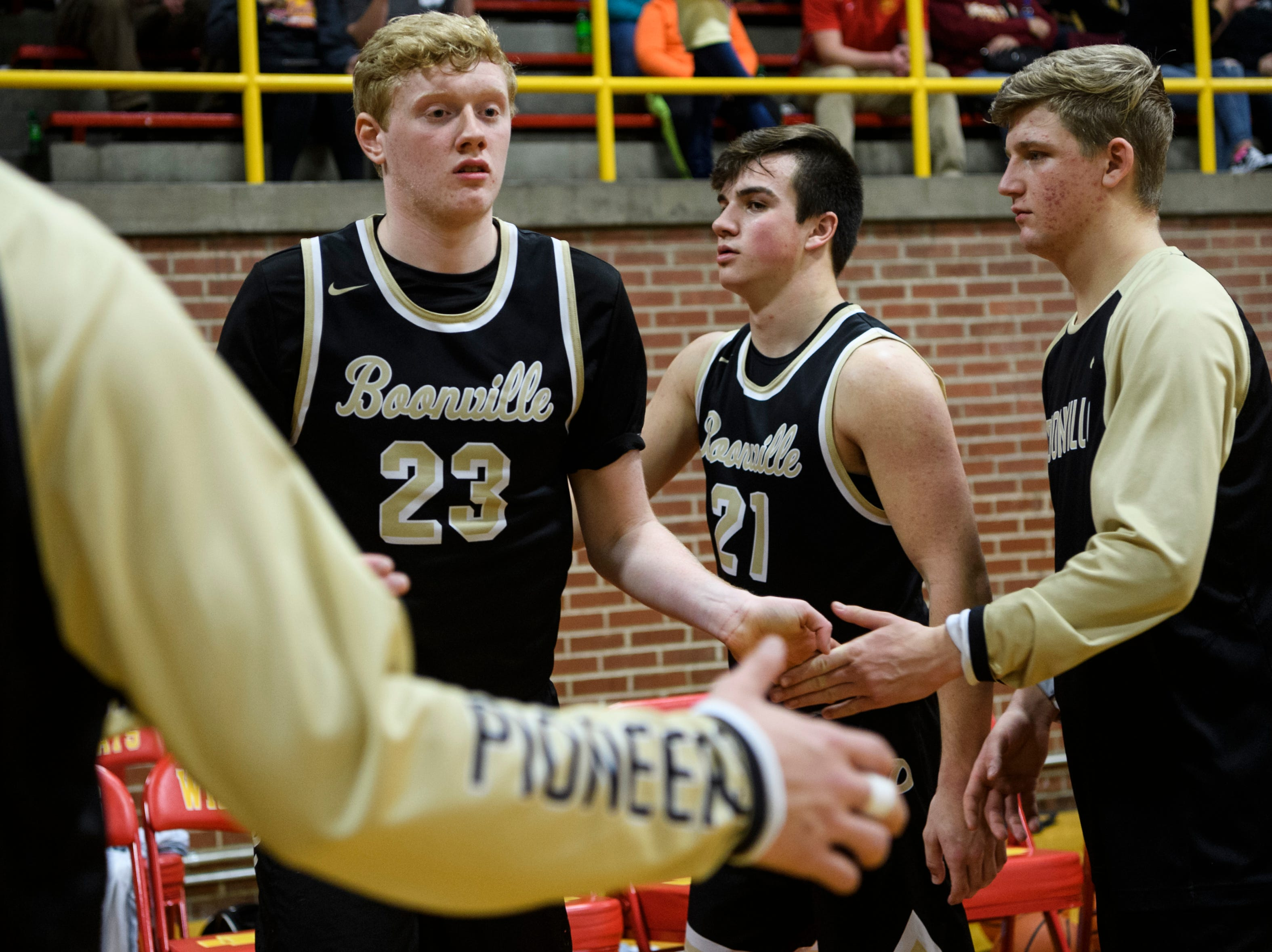Boonville's Hunter Bruce (23) receives high-fives from his teammates as their starting line up is announced before taking on the Mater Dei Wildcats at Mater Dei High School in Evansville, Ind., Saturday, Jan. 5, 2019. The Wildcats defeated the Pioneers, 93-65.