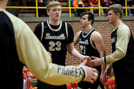Boonville's Hunter Bruce (23) receives high-fives from his teammates as their starting line up is announced before taking on the Mater Dei Wildcats at Mater Dei High School in Evansville, Ind., Saturday, Jan. 5, 2019.