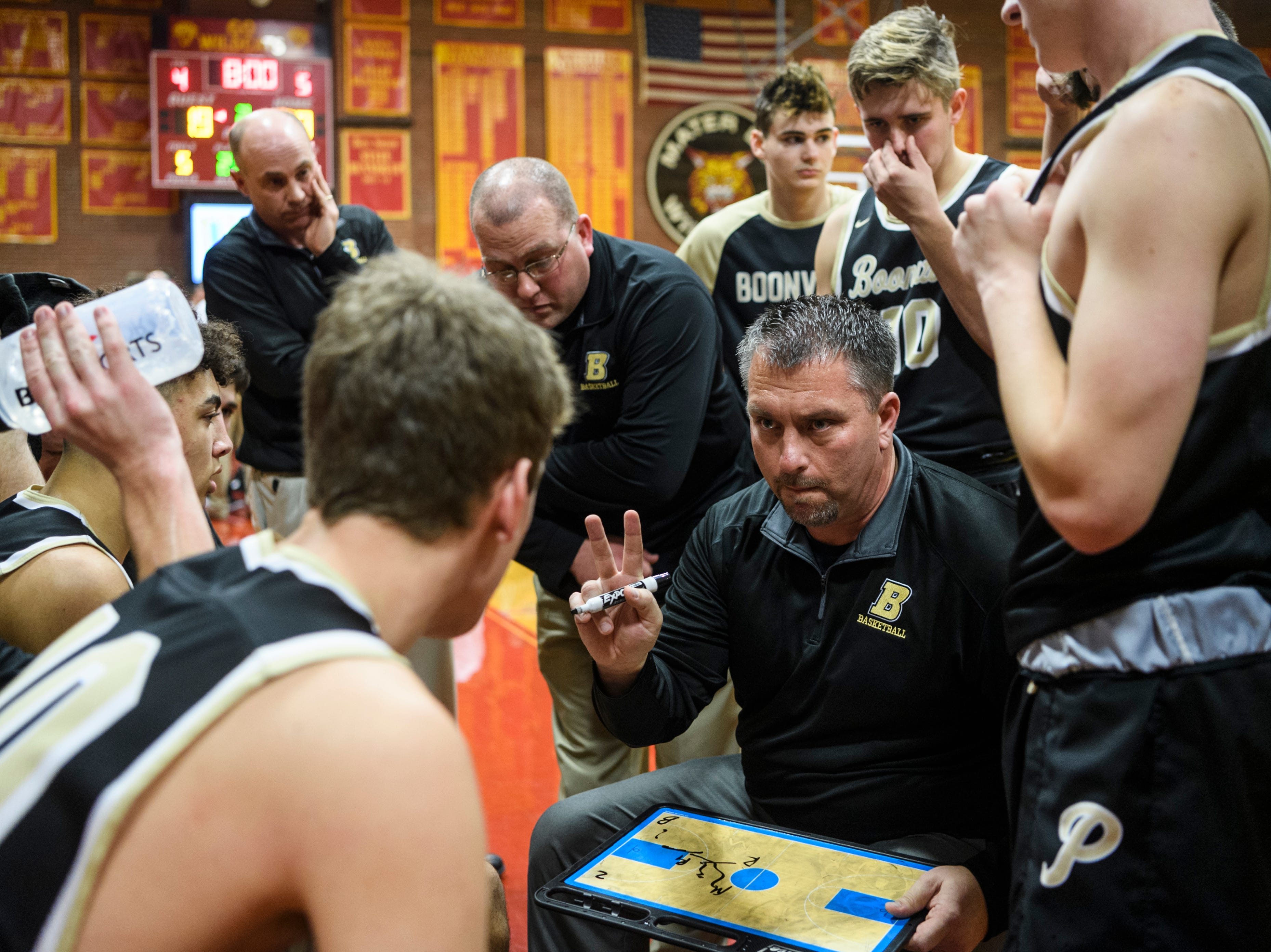 Boonville Head Coach Brian Schoonover talks to his team before the start of the second quarter against the Mater Dei Wildcats at Mater Dei High School in Evansville, Ind., Saturday, Jan. 5, 2019. The Wildcats defeated the Pioneers, 93-65.