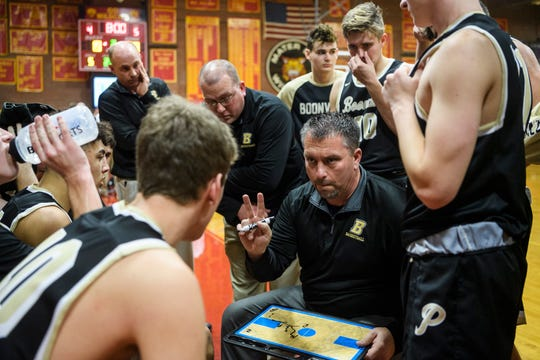Boonville Head Coach Brian Schoonover talks to his team before the start of the second quarter against Mater Dei Wildcats. Schoonover announced his resignation after two seasons.