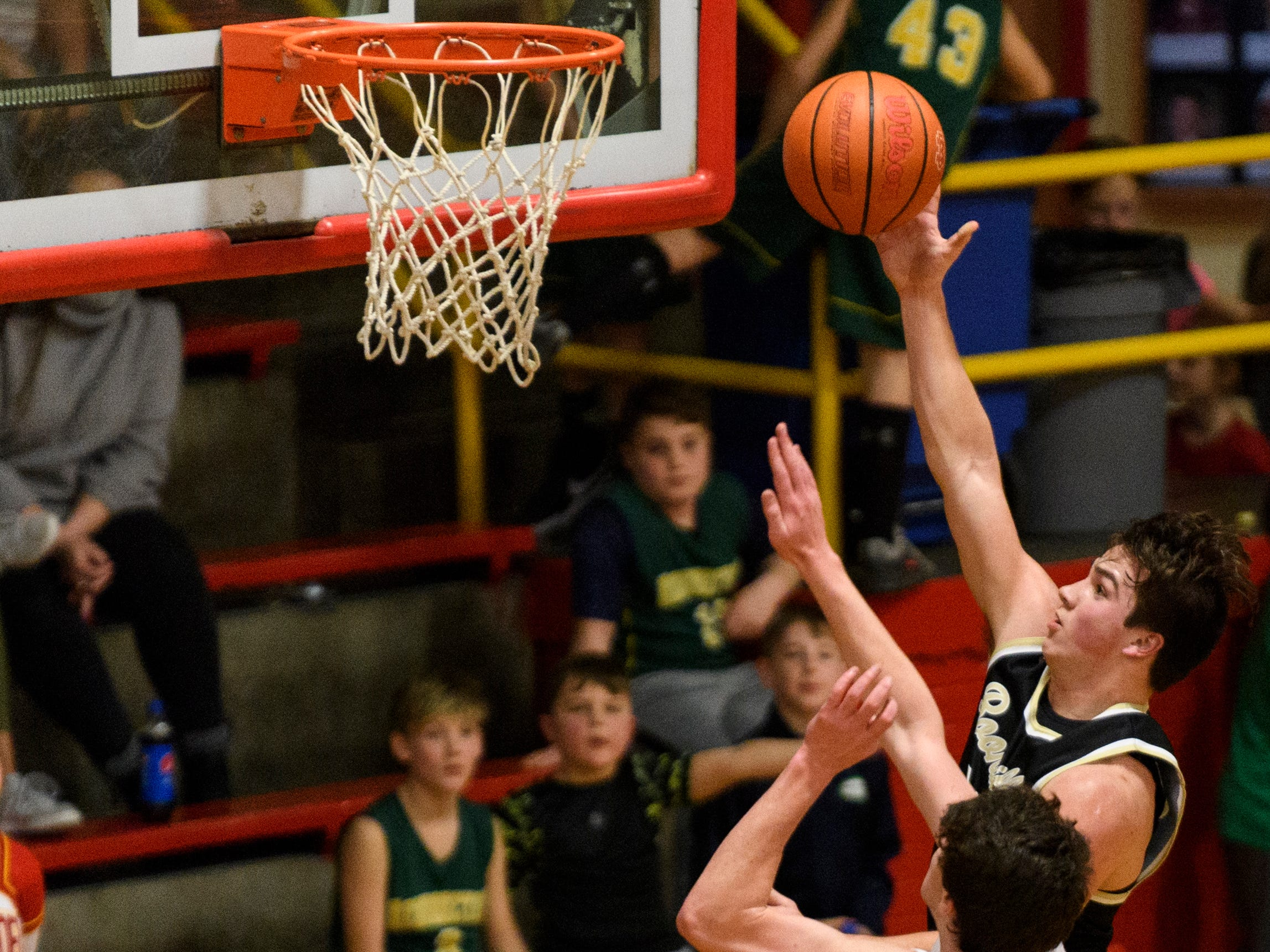 Boonville's Luke Conner (21) goes up for a lay-up during the fourth quarter against the Mater Dei Wildcats at Mater Dei High School in Evansville, Ind., Saturday, Jan. 5, 2019. The Wildcats defeated the Pioneers, 93-65.