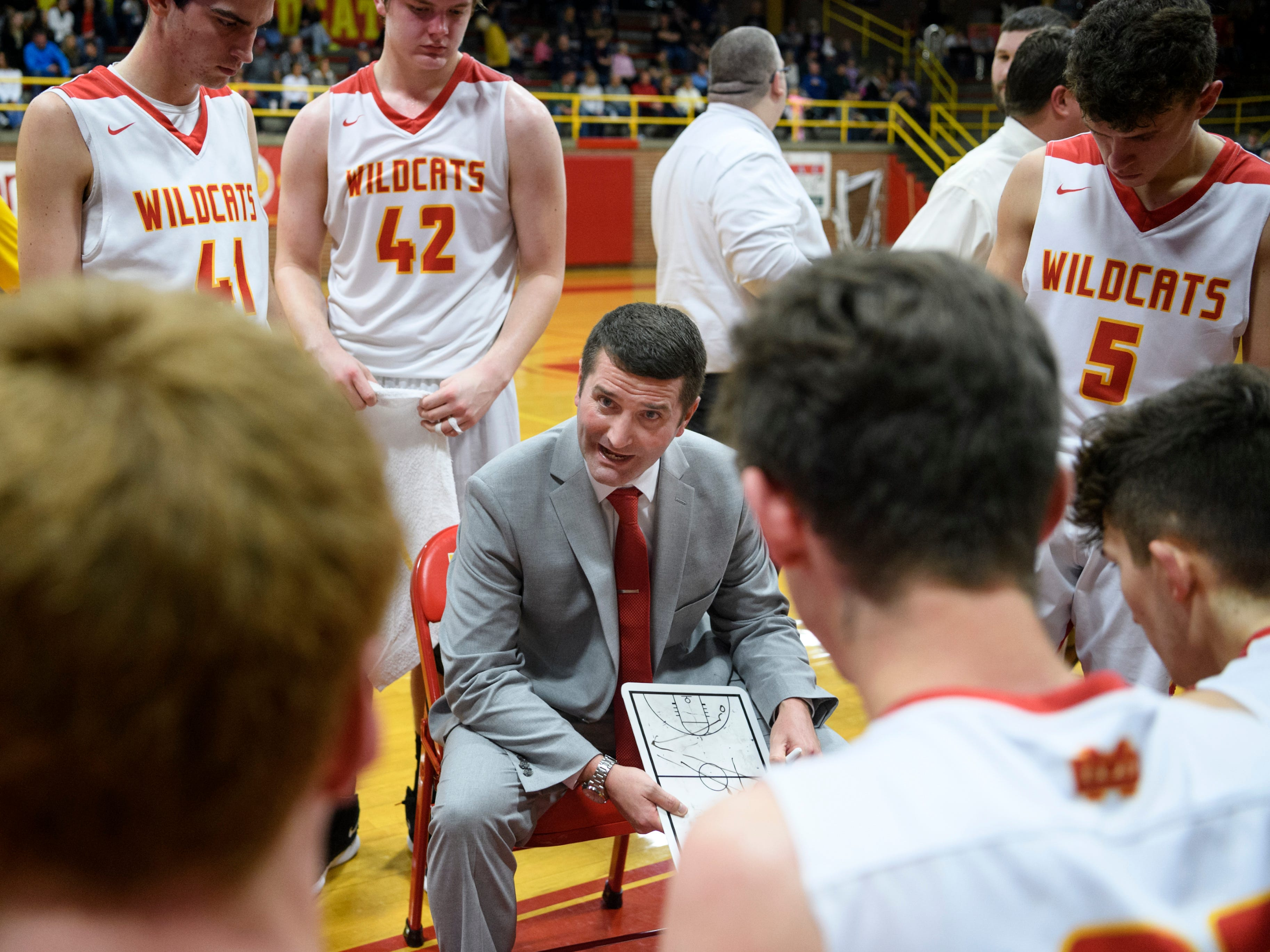 Mater Dei Head Coach Kurt Wildeman talks to his team during a second quarter time-out against the Boonville Pioneers at Mater Dei High School in Evansville, Ind., Saturday, Jan. 5, 2019. The Wildcats defeated the Pioneers, 93-65.