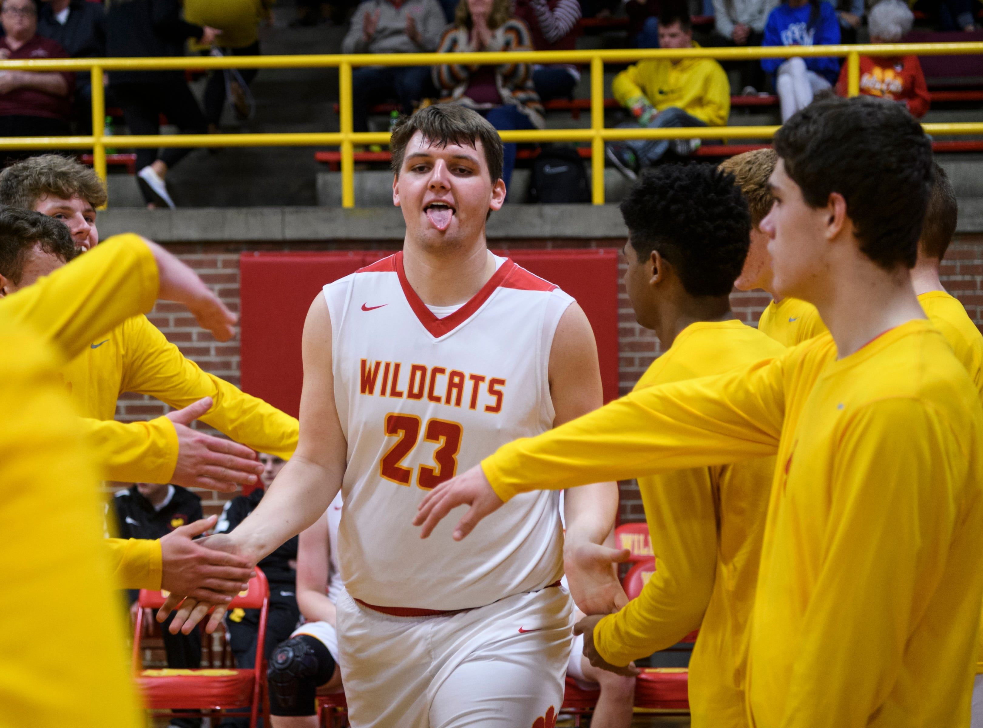 Mater Dei's Logan Carter (23) is announced on his team's starting line up before taking on the Boonville Pioneers at Mater Dei High School in Evansville, Ind., Saturday, Jan. 5, 2019. The Wildcats defeated the Pioneers, 93-65.