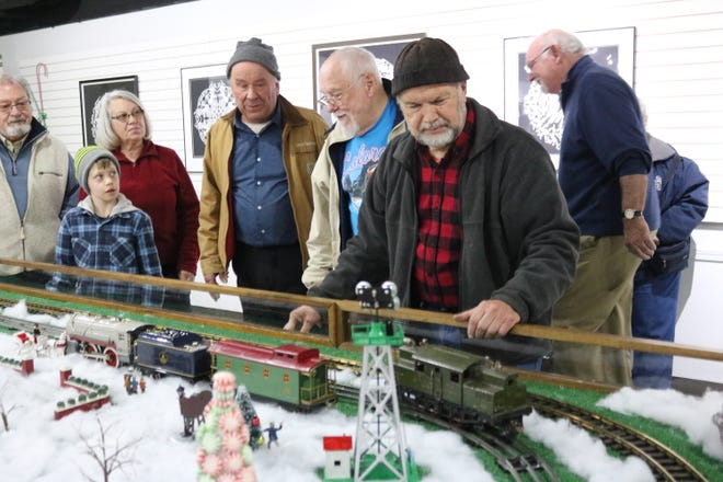 Louis Visi, right, test runs a vintage Ives model locomotive he bought last month at the Rutherford B. Hayes Presidential Library and Museums' annual model train clinic.