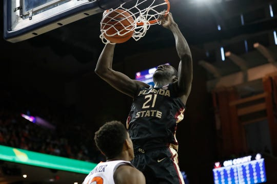 Florida State center Christ Koumadje dunks the ball against Virginia at John Paul Jones Arena.