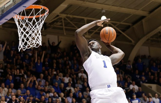 Duke's Zion Williamson (1) drives for a dunk against Clemson Saturday night in Durham, N.C.