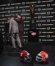 Alabama coach Nick Saban, left, and Clemson Head Coach Dabo Swinney leave the stage after posing with the championship trophy during the College Football Playoff Championship coaches press conference in San Jose, California January 6, 2019.