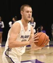 Matt Rafferty had 26 points and 10 rebounds as Furman got past UNC Greensboro 67-57 on Thursday night.