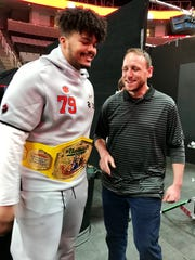 Clemson's Jackson Carman tries on Joey Chestnut's world hot dog eating championship belt Saturday.