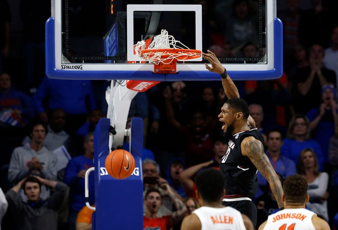 South Carolina forward Chris Silva (30) dunks for the game-winning basket with 2.5 second left during the second half against the Florida Gators at Exactech Arena Saturday night in Gainesville, Fla.