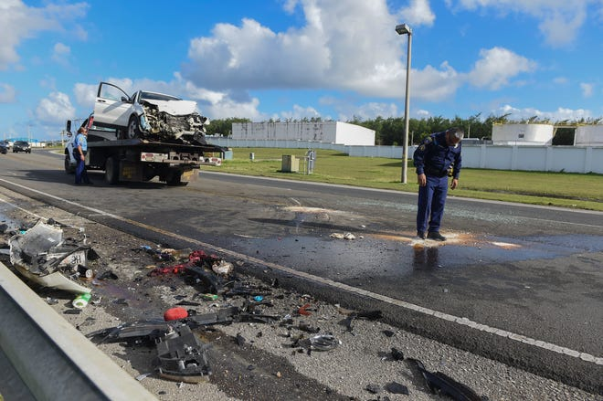 Guam Police Department officers investigate the scene of a reported two-car collision involving a Honda CR-V and a Nissan Frontier on Route 10A in Barrigada, Jan. 6, 2019.