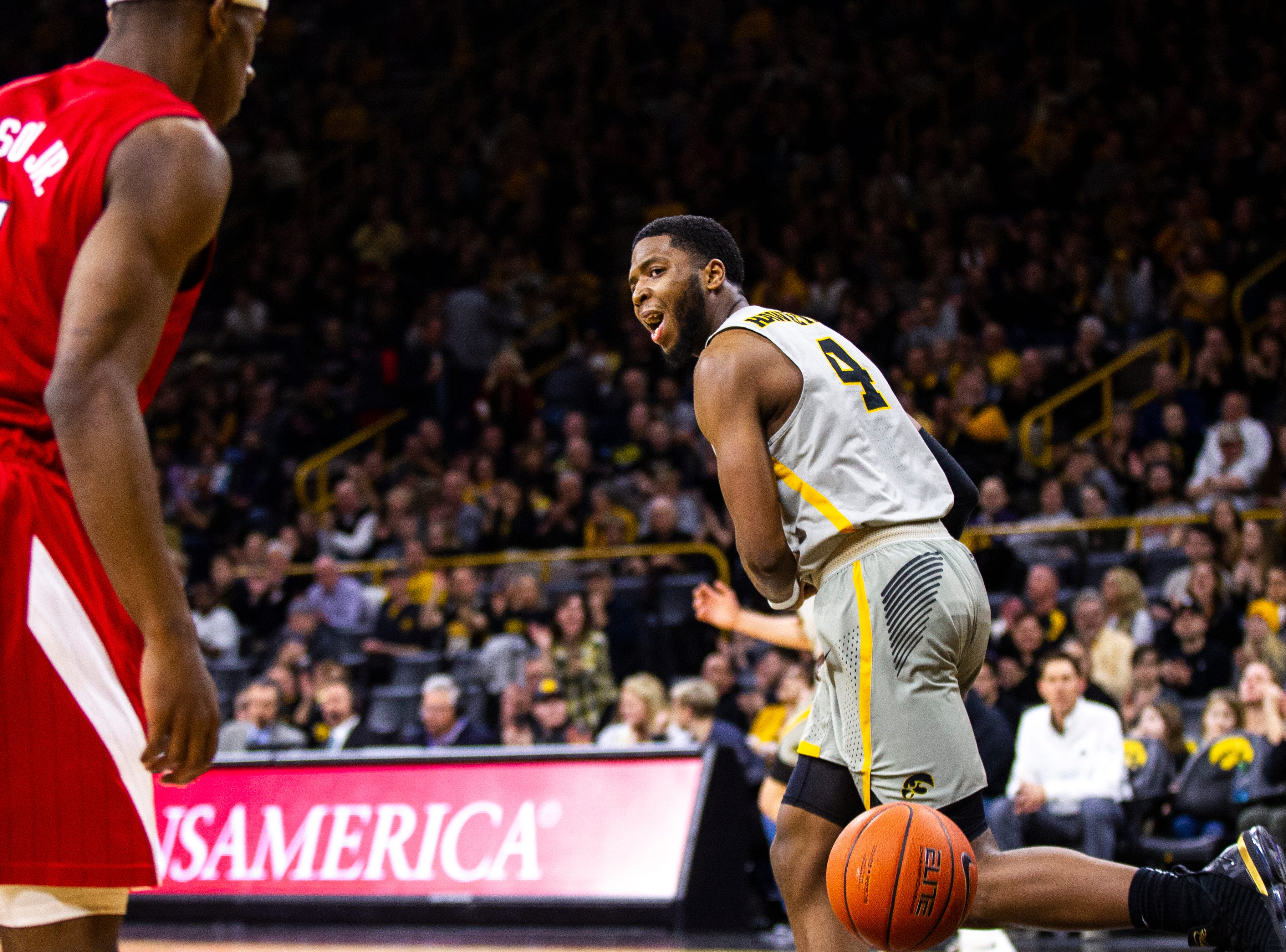 Iowa guard Isaiah Moss (4) reacts after making a layup past Nebraska guard Glynn Watson Jr. (5) during a NCAA Big Ten Conference men's basketball game on Sunday, Jan. 6, 2019, at the Carver-Hawkeye Arena in Iowa City, Iowa.