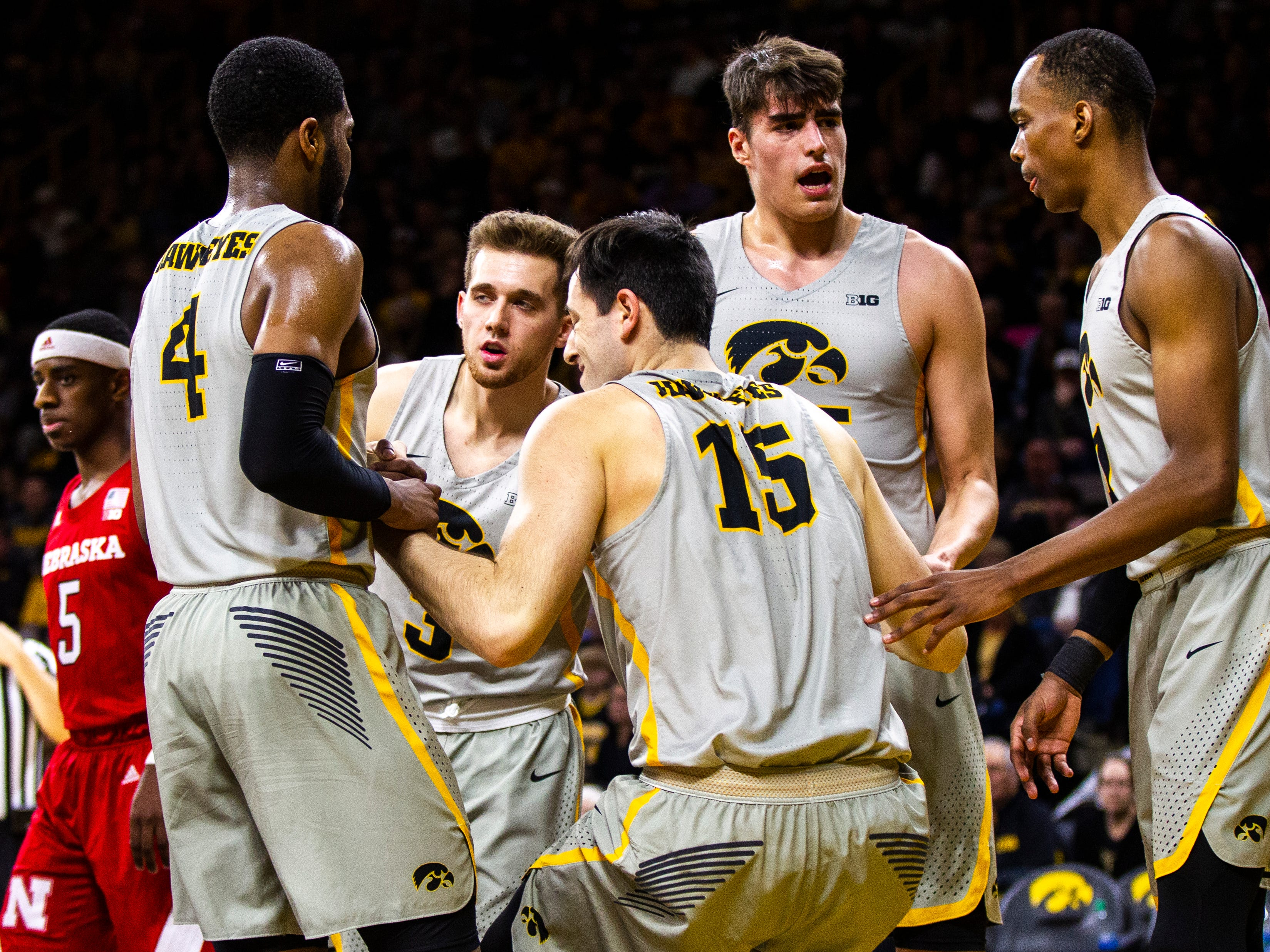 Iowa forward Ryan Kriener (15) gets helped up by teammates Iowa guard Isaiah Moss (4) Iowa guard Isaiah Moss (4) Iowa forward Luka Garza (55) and Iowa guard Maishe Dailey (1) during a NCAA Big Ten Conference men's basketball game on Sunday, Jan. 6, 2019, at the Carver-Hawkeye Arena in Iowa City, Iowa.