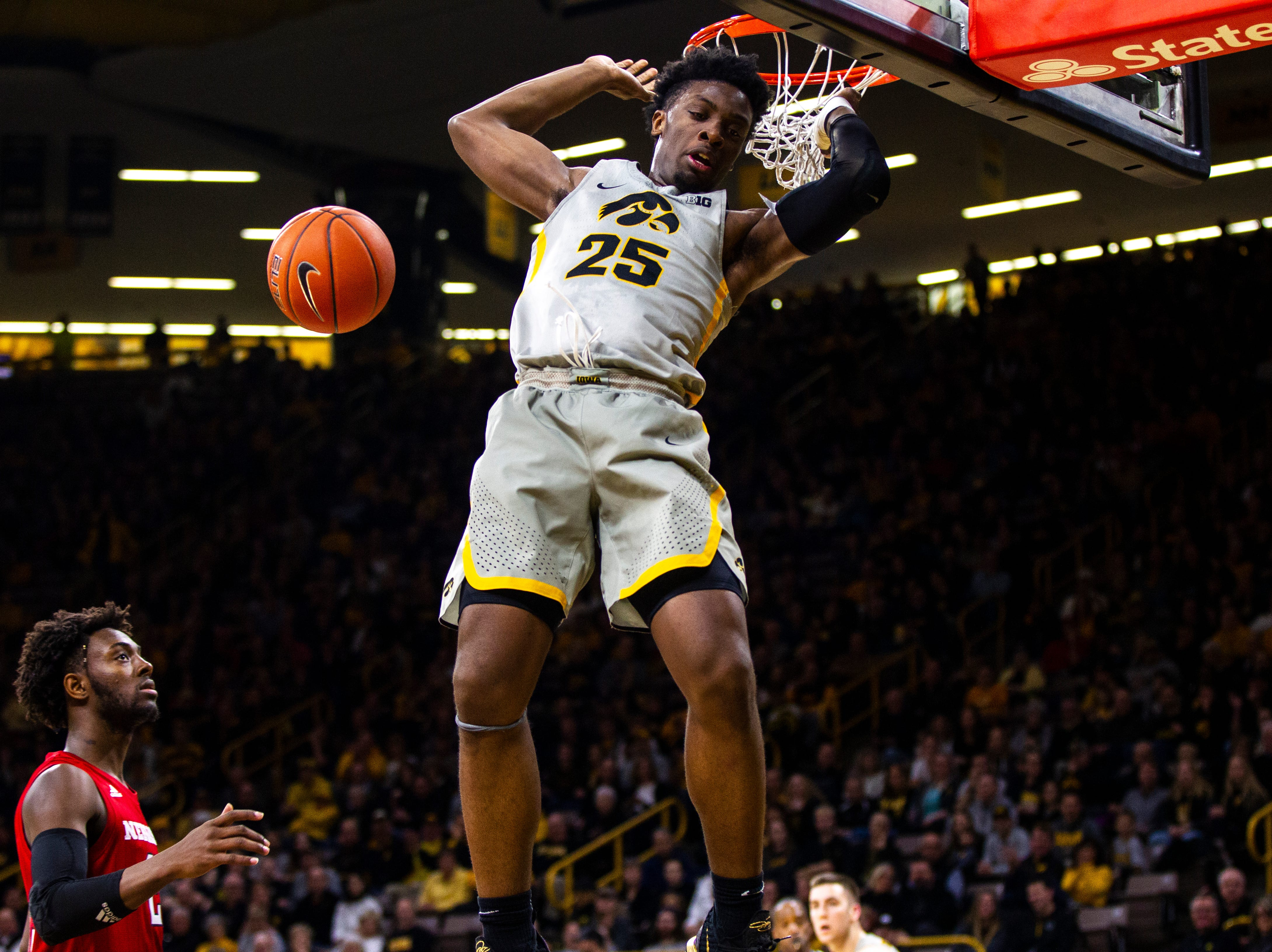 Iowa forward Tyler Cook (25) comes off the rim after a dunk during a NCAA Big Ten Conference men's basketball game on Sunday, Jan. 6, 2019, at the Carver-Hawkeye Arena in Iowa City, Iowa.