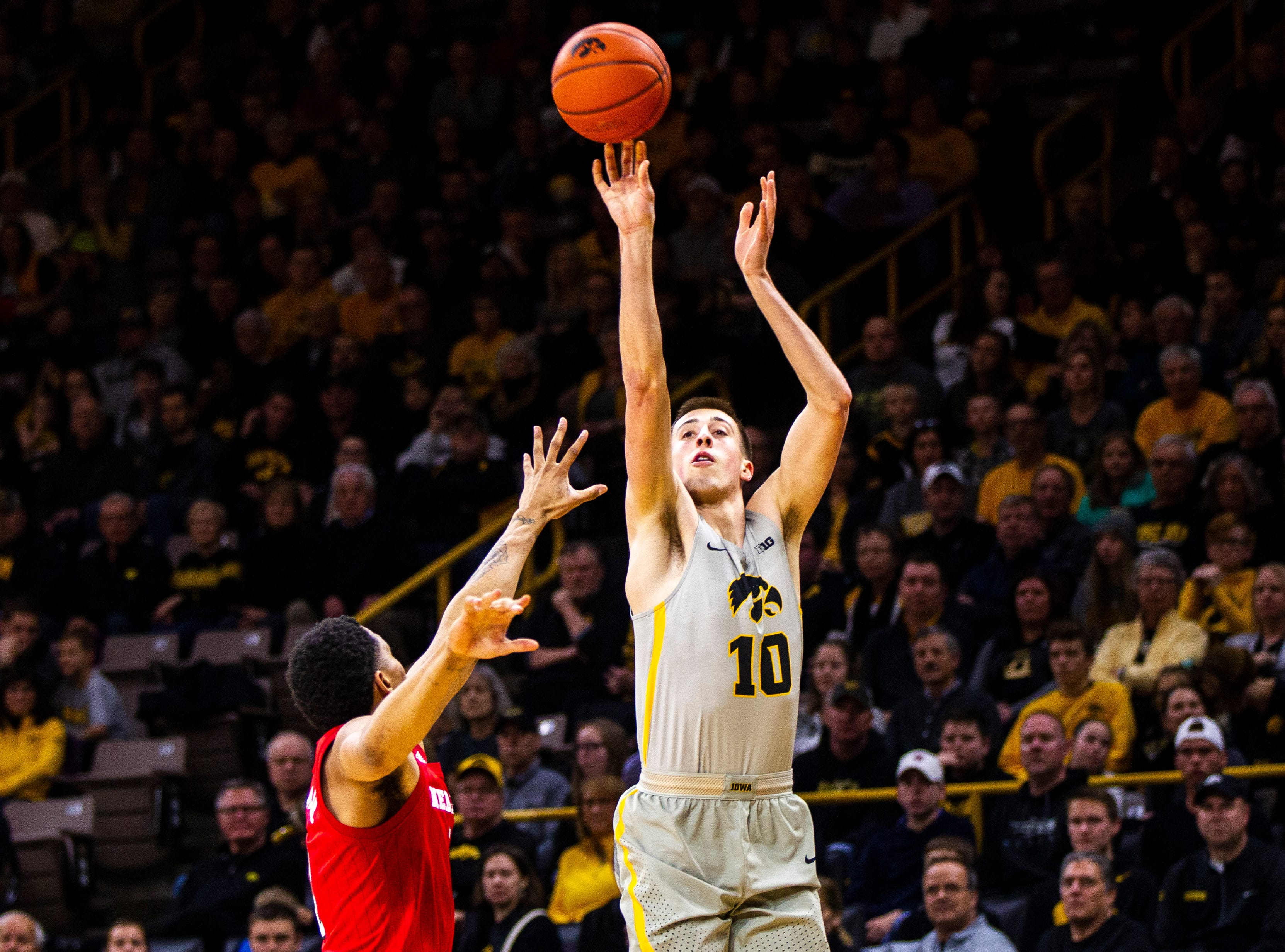 Iowa guard Joe Wieskamp (10) shoots a 3-point basket during a NCAA Big Ten Conference men's basketball game on Sunday, Jan. 6, 2019, at the Carver-Hawkeye Arena in Iowa City, Iowa.