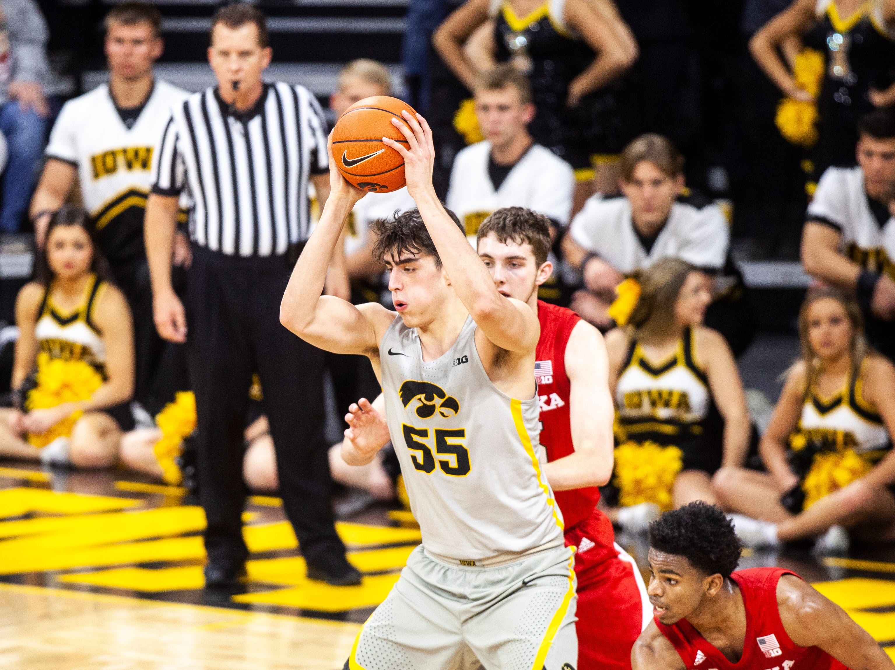 Iowa forward Luka Garza (55) looks to pass during a NCAA Big Ten Conference men's basketball game on Sunday, Jan. 6, 2019, at the Carver-Hawkeye Arena in Iowa City, Iowa.
