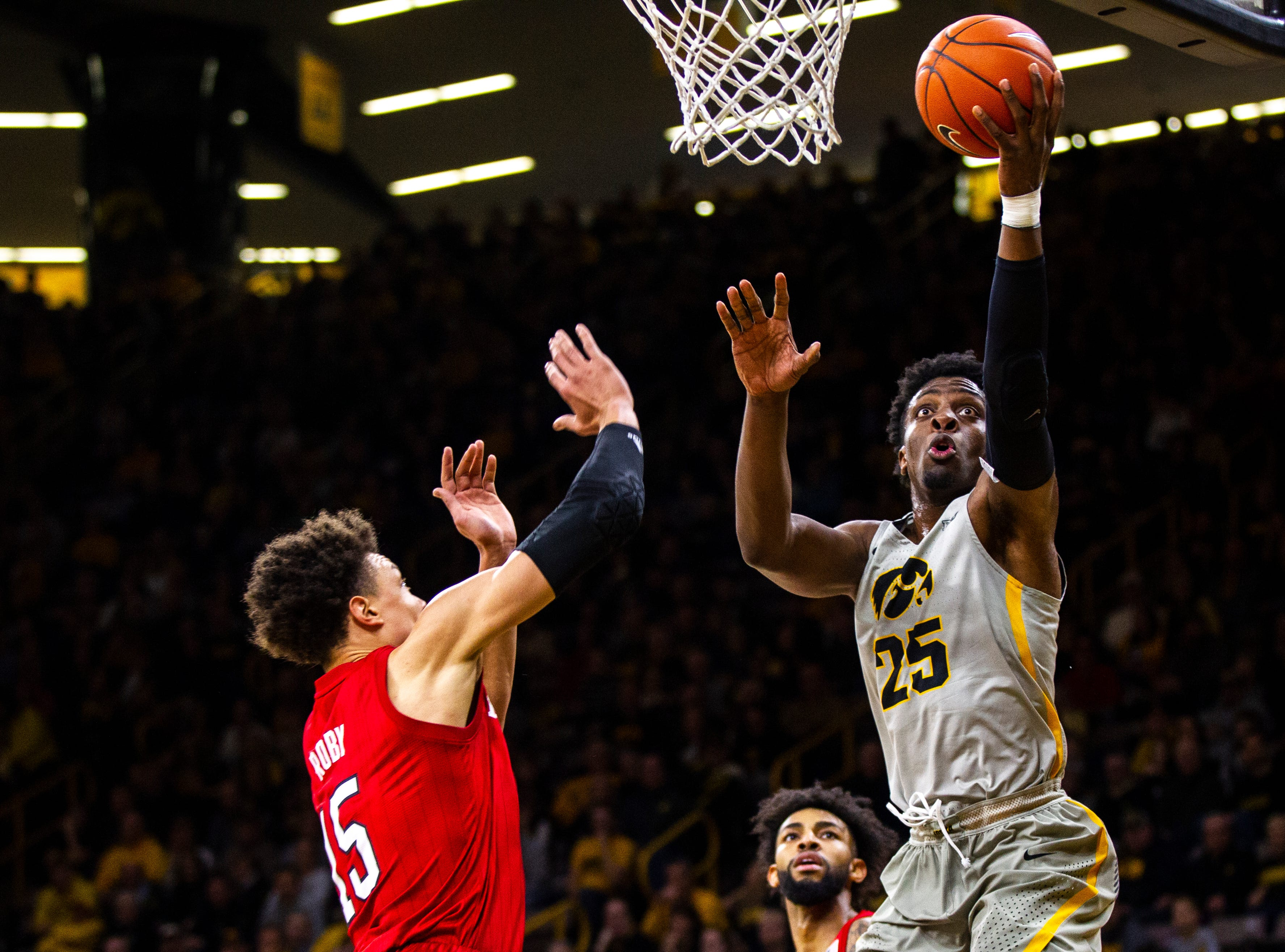 Iowa forward Tyler Cook (25) attempts a basket past Nebraska forward Isaiah Roby (15) during a NCAA Big Ten Conference men's basketball game on Sunday, Jan. 6, 2019, at the Carver-Hawkeye Arena in Iowa City, Iowa.