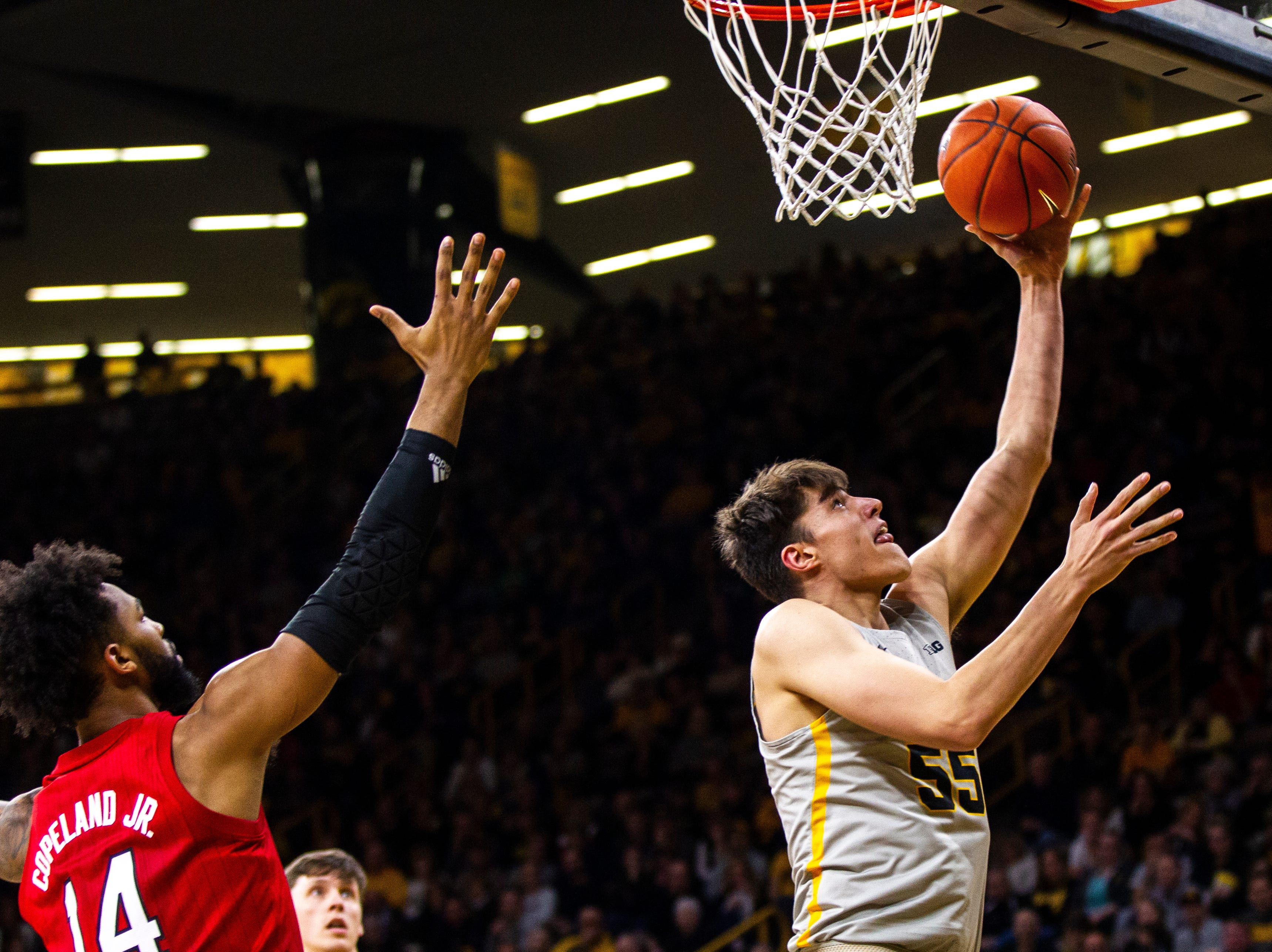Iowa forward Luka Garza (55) makes a layup during a NCAA Big Ten Conference men's basketball game on Sunday, Jan. 6, 2019, at the Carver-Hawkeye Arena in Iowa City, Iowa.