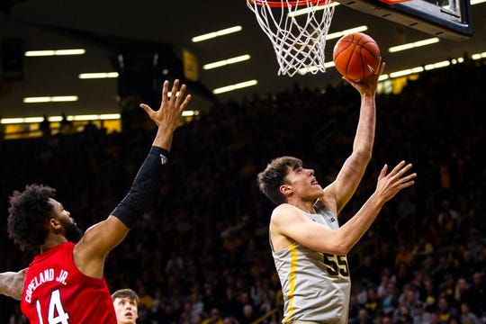 Iowa center Luka Garza makes a layup during the first half against Nebraska on Sunday. The sophomore came off the bench to provide a spark in his first action in four games. He had been out with a sprained left ankle.