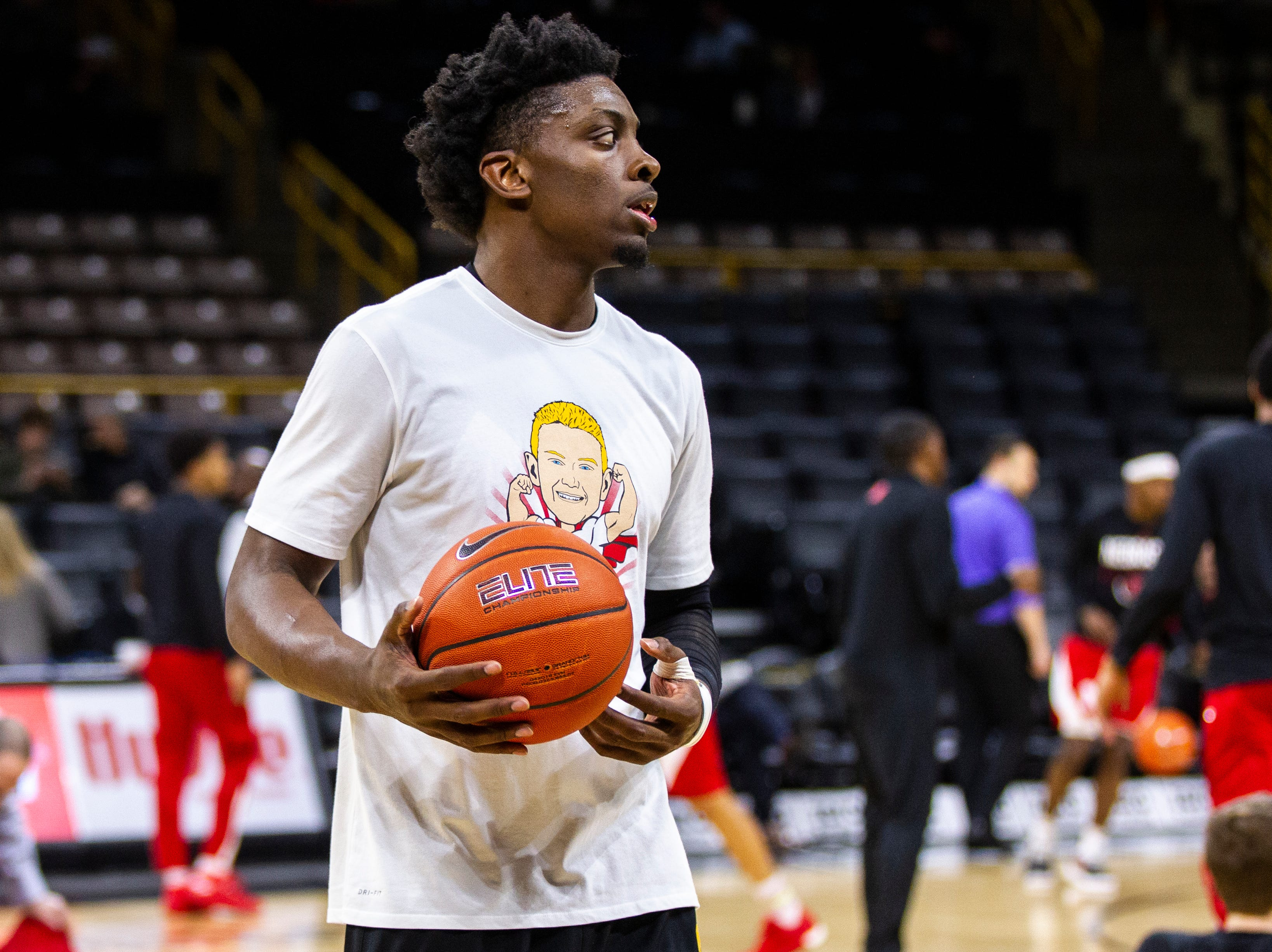 Iowa forward Tyler Cook warms up while wearing a shirt featuring a logo for Tate Schaefer, an 11-year-old from Williamsburg who has a tumor in his brain before a NCAA Big Ten Conference men's basketball game on Sunday, Jan. 6, 2019, at the Carver-Hawkeye Arena in Iowa City, Iowa.
