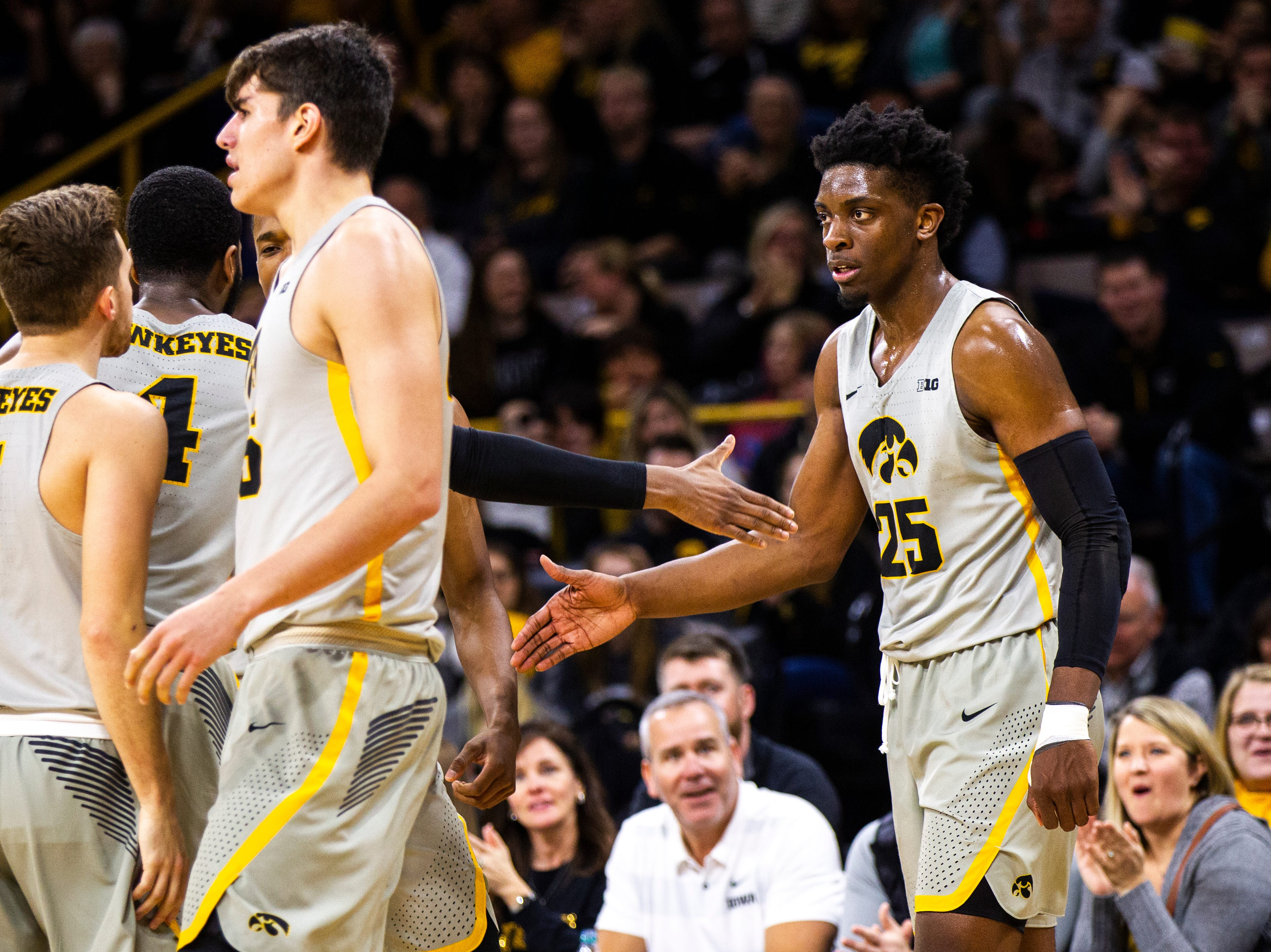 Iowa forward Tyler Cook (25) gets a high-five from Iowa guard Isaiah Moss (4) after drawing a foul during a NCAA Big Ten Conference men's basketball game on Sunday, Jan. 6, 2019, at the Carver-Hawkeye Arena in Iowa City, Iowa.