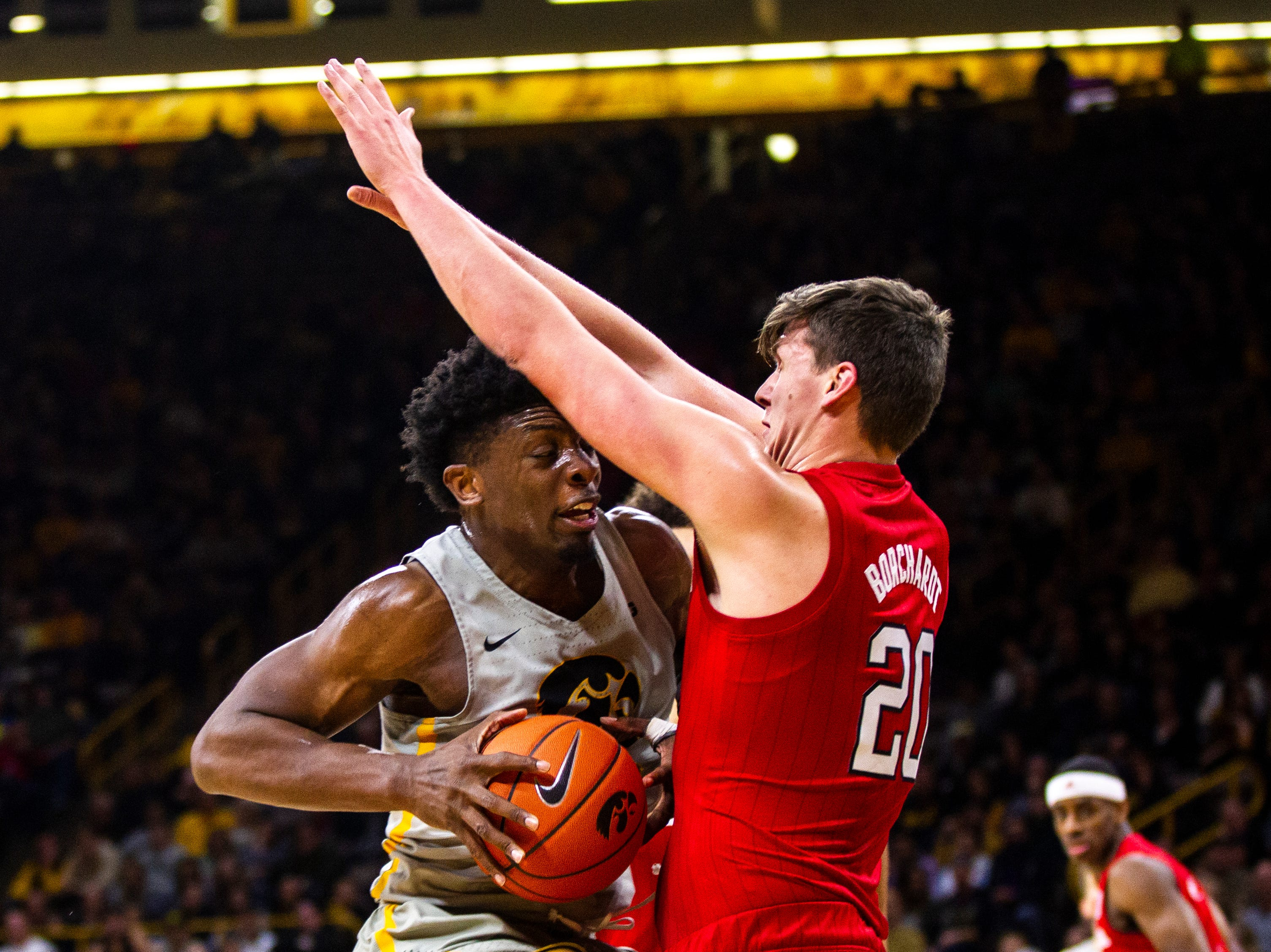 Iowa forward Tyler Cook (25) charges Nebraska forward Tanner Borchardt (20) during a NCAA Big Ten Conference men's basketball game on Sunday, Jan. 6, 2019, at the Carver-Hawkeye Arena in Iowa City, Iowa.